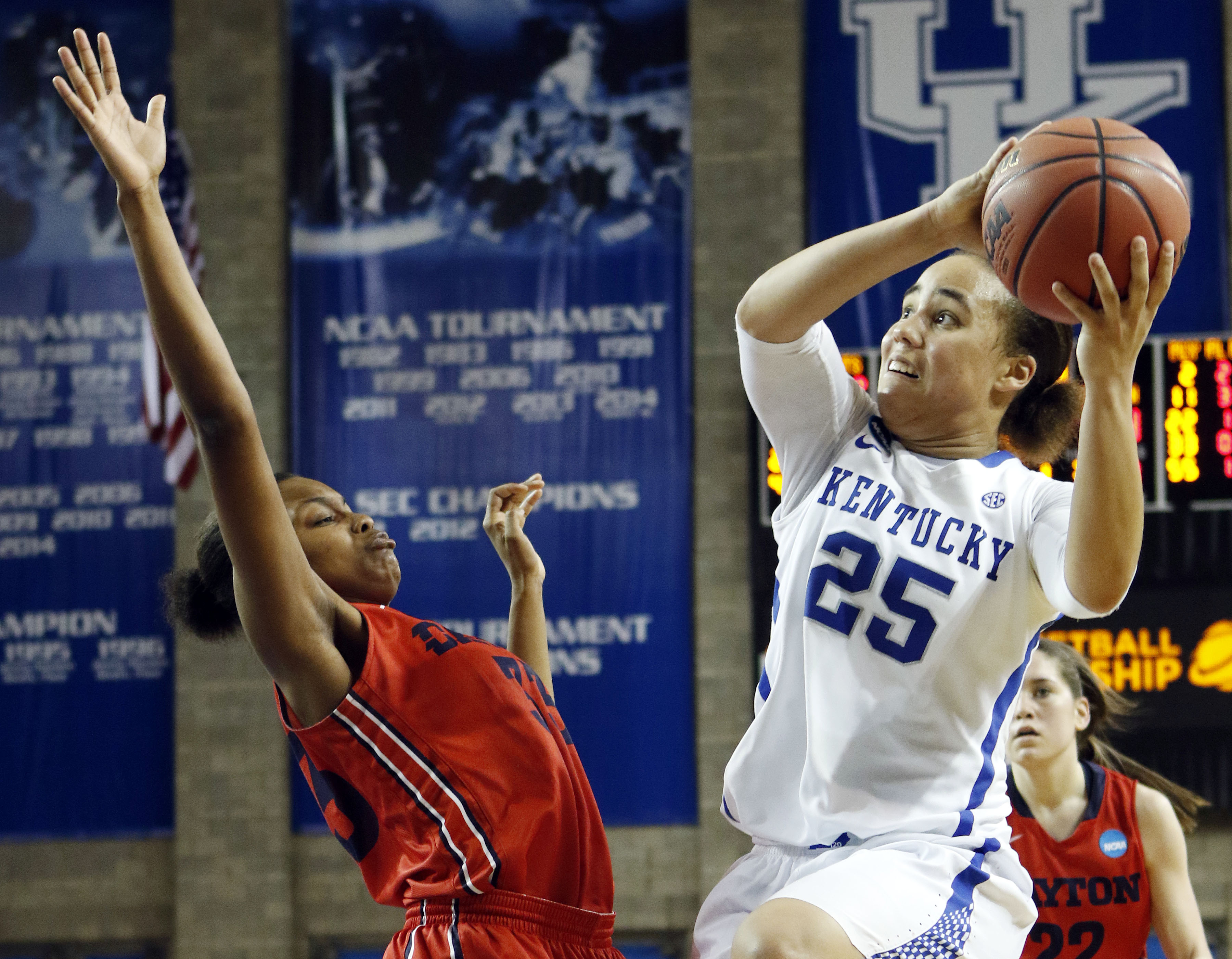 Kentucky's Makayla Epps (25) shoots while defended by Dayton's Javonna Layfield during the second half of a women's college basketball game in the second round of the NCAA tournament in Lexington, Ky., Sunday, March 22, 2015. Dayton won 99-94. (AP Photo/J