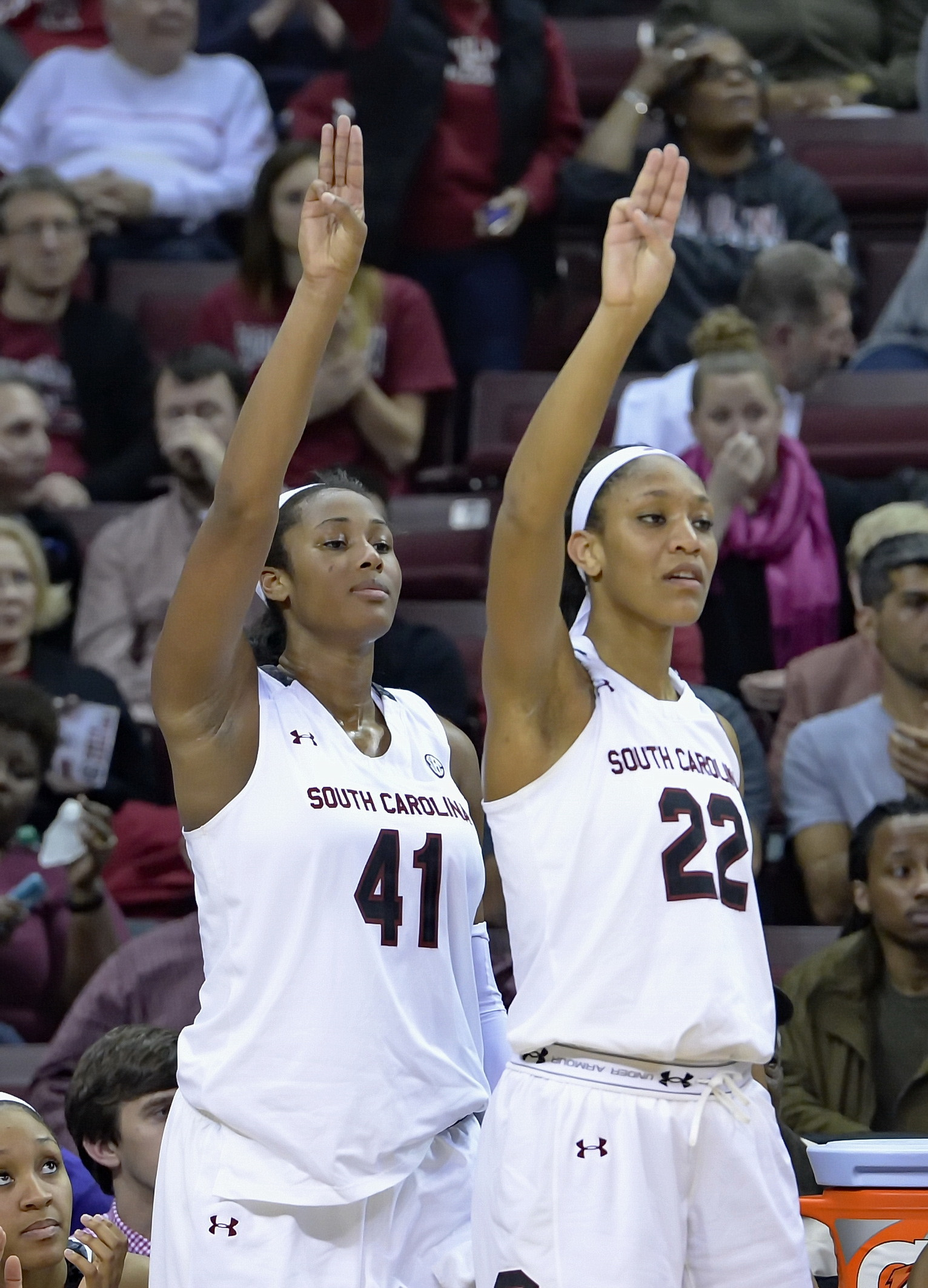 FILE- In this Jan. 29, 2015, file photo, South Carolina's A'ja Wilson, right, and Alaina Coates react to a 3-point shot by teammate Tina Roy, not shown, during the second half of an NCAA college basketball game against Alabama in Columbia, S.C. South Caro