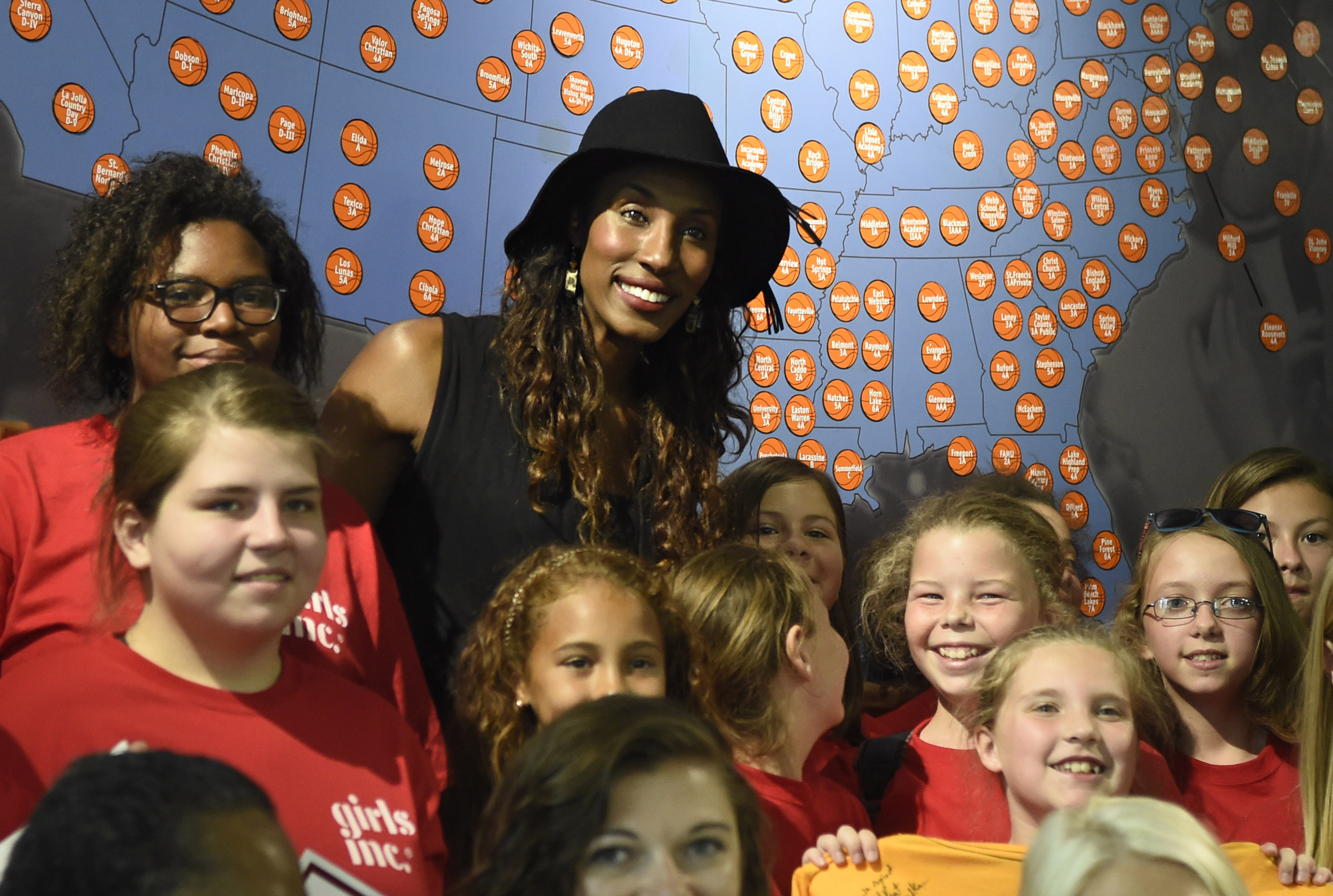 Lisa Leslie, former WNBA basketball player and 2015 Women's Basketball Hall of Fame inductee, center, poses for a photo with children during an autograph session at the Women's Basketball Hall of Fame on Saturday, June 13, 2015 in Knoxville, Tenn. (Adam L