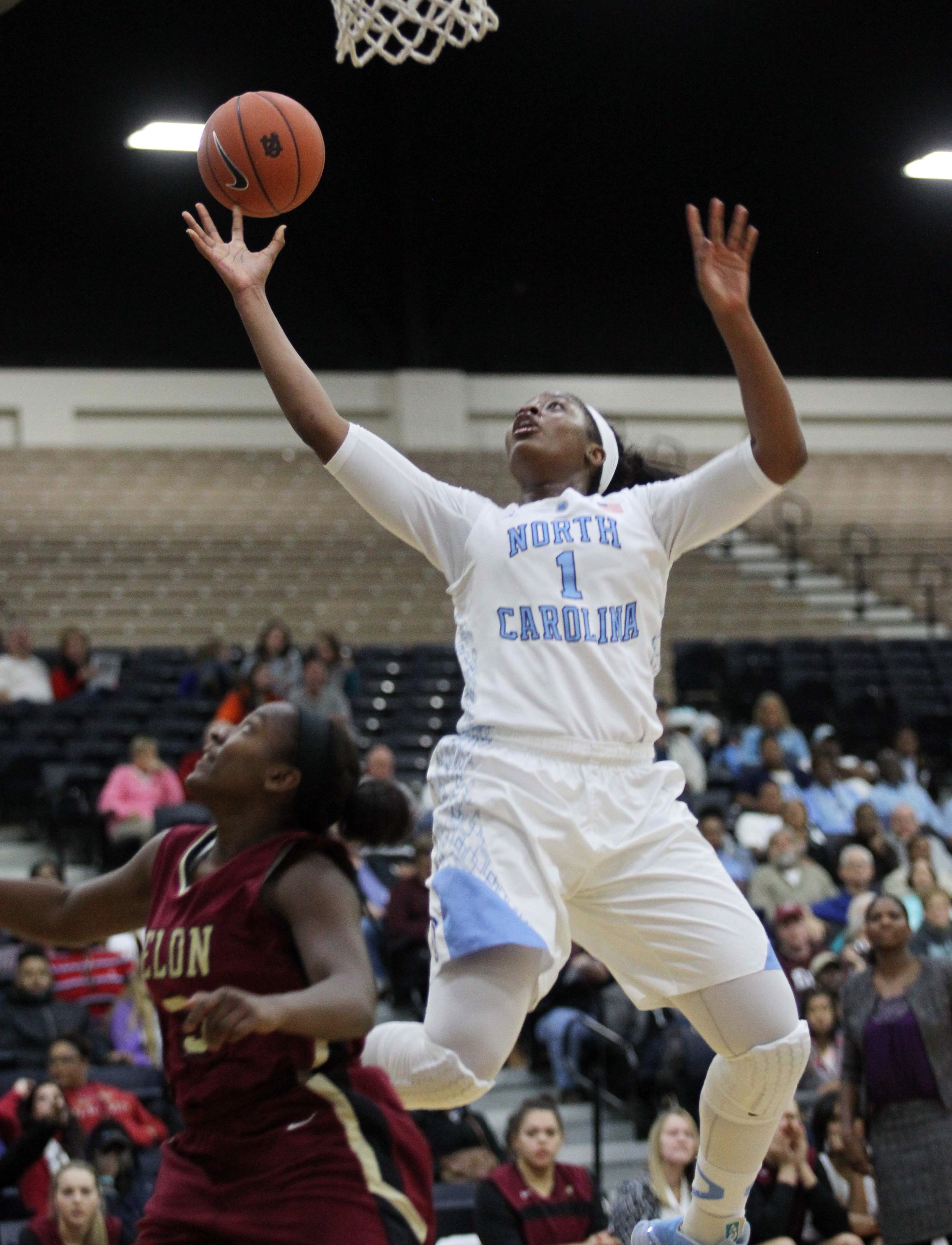North Carolina Tar Heels Stephanie Mavunga (1) goes up for a rebound over Elon Phoenix's Shay Burnett (5) in the first half of an NCAA women's college basketball at the Carolinas Classic at the Myrtle Beach Convention Center in Myrtle Beach,  S.C. on Sund