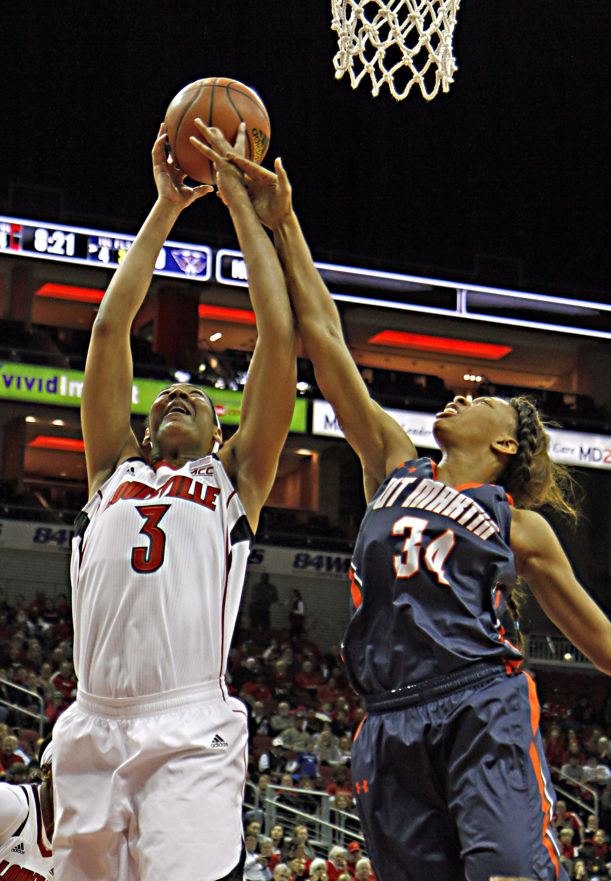 Louisville center Sheronne Vails (3) goes high to grab a rebound away from Tennessee-Martin forward Ashia Jones (34) in their NCAA college basketball game in Louisville, Ky., Sunday, Nov. Nov. 16, 2014. (AP Photo/Garry Jones)