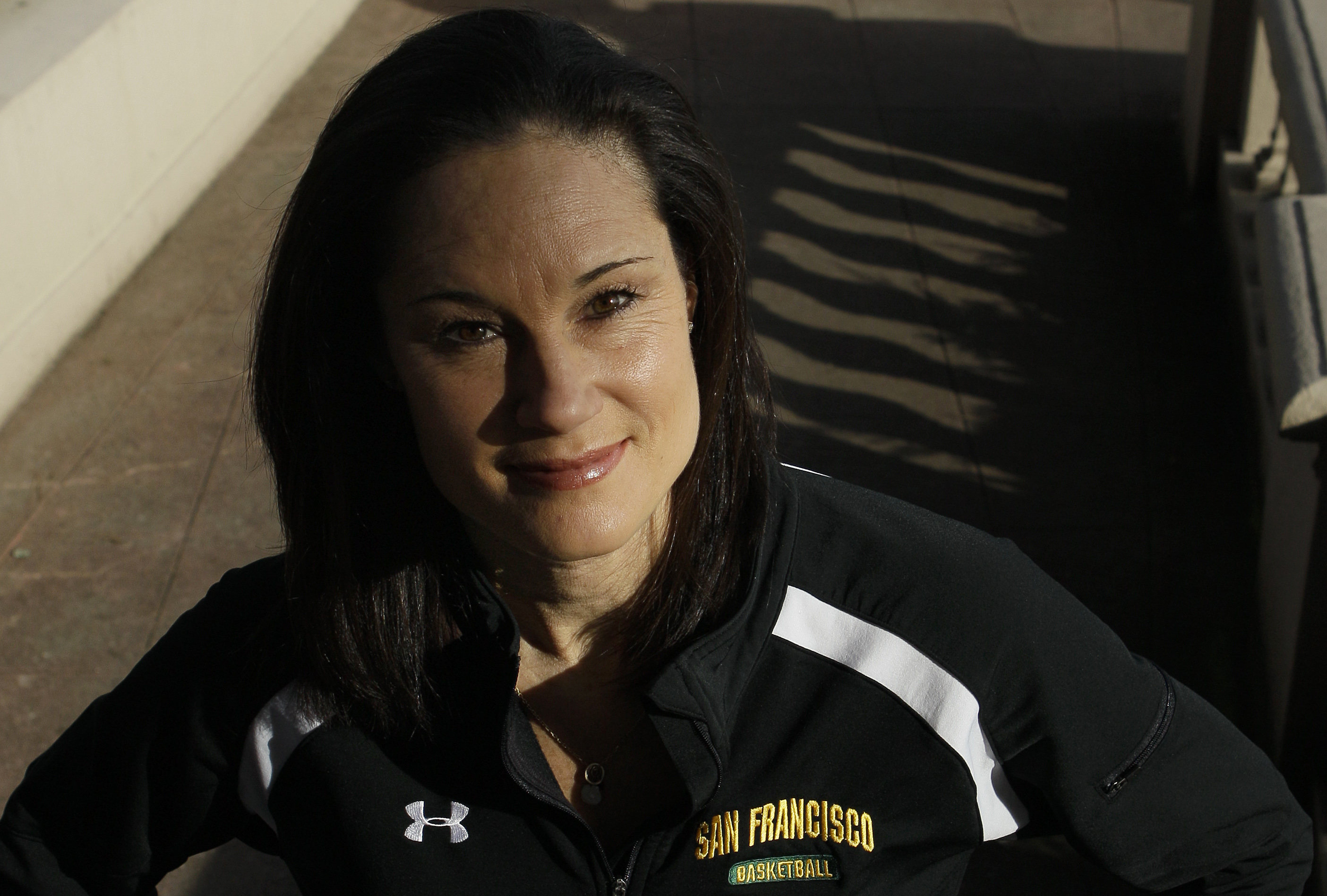 This photo made Dec. 17, 2010, shows San Francisco women's basketball coach Jennifer Azzi posing on the campus in San Francisco, Friday, Dec. 17, 2010. The 42-year-old Azzi could have coached many times over the years at various levels, but it never felt
