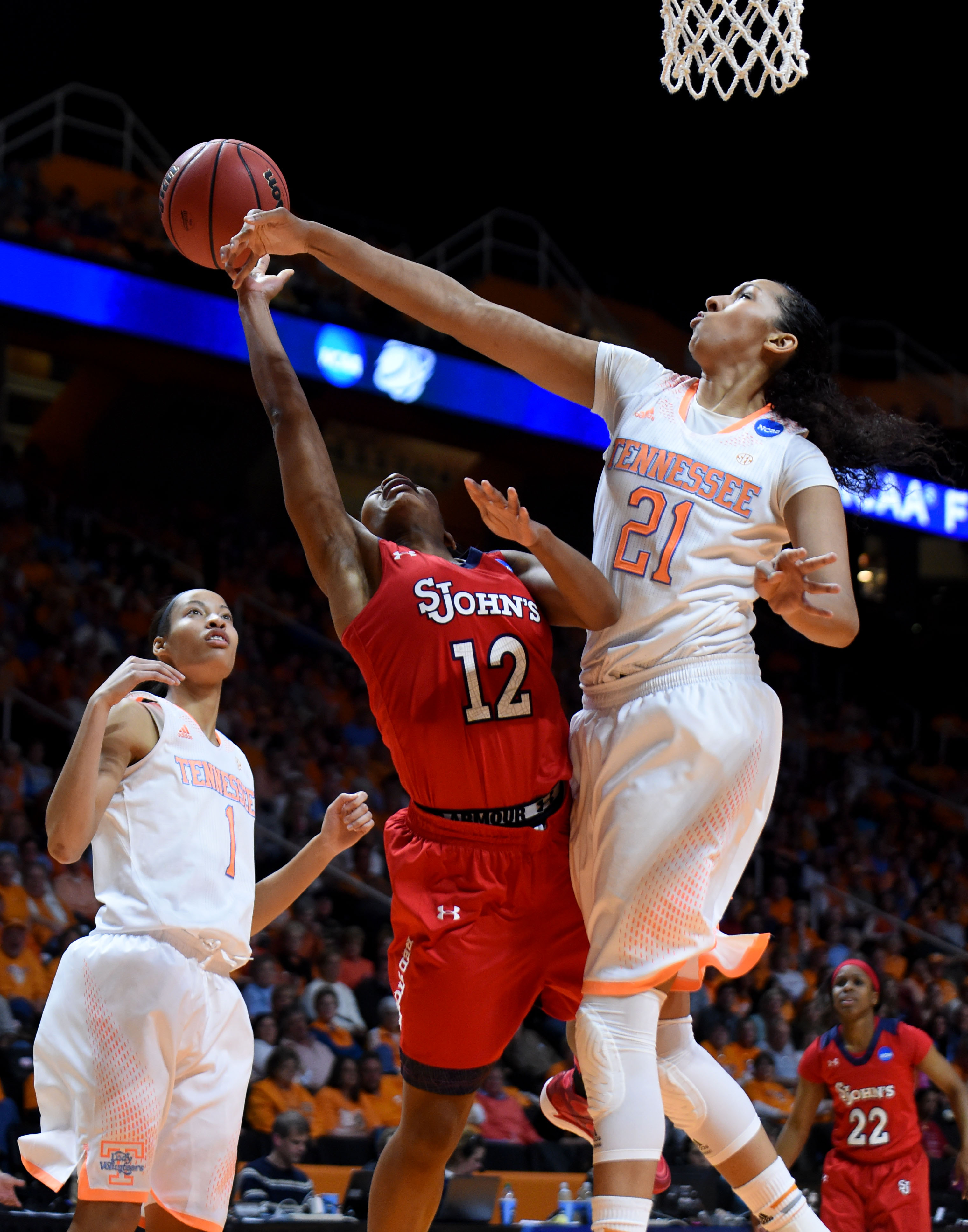 In this March 24, 2014, photo, Tennessee center Mercedes Russell, right, blocks a shot by St. John's guard Briana Brown during the NCAA college women's basketball tournament in Knoxville, Tenn. After helping the United States win a gold medal at last mont