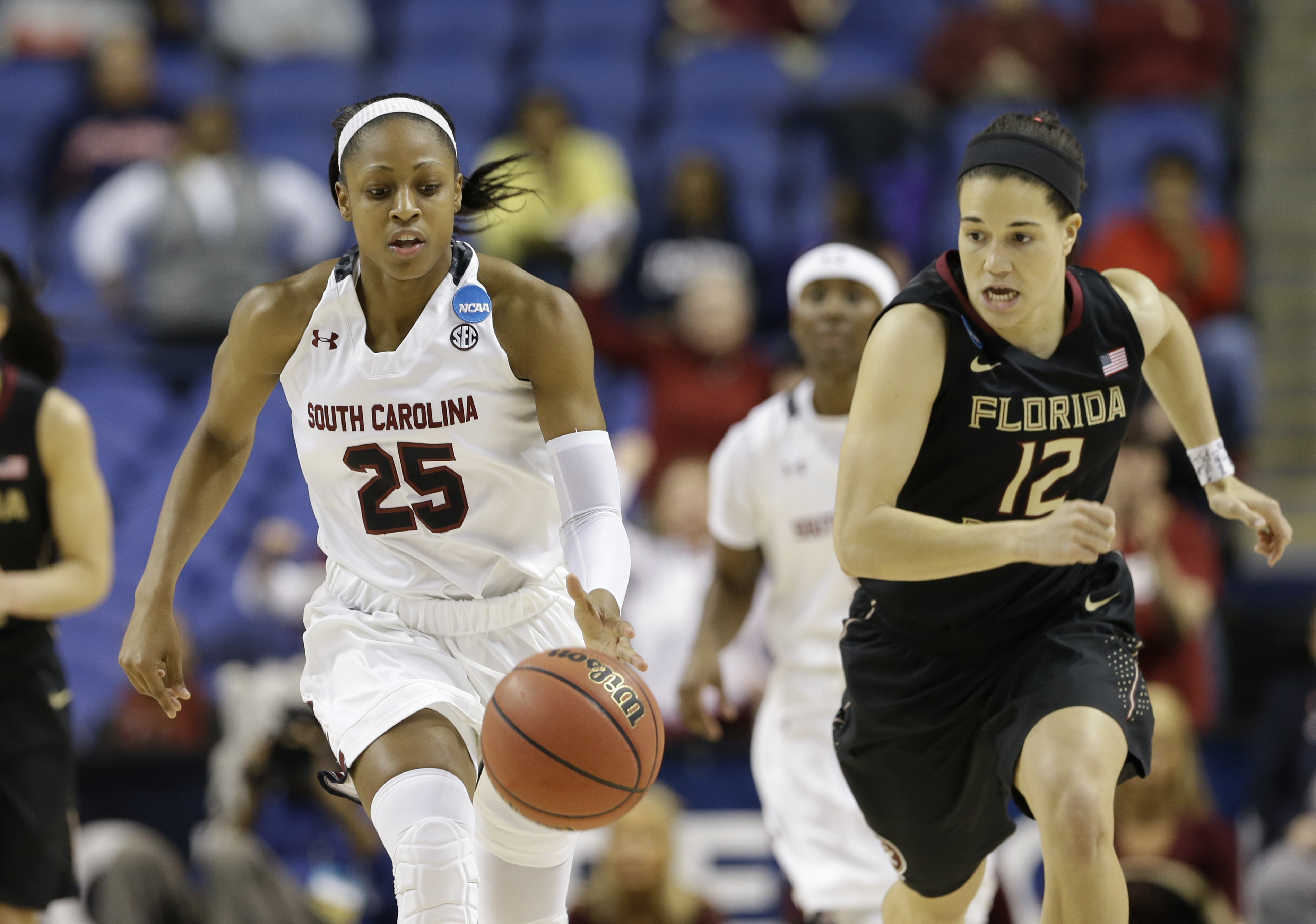 South Carolina's Tiffany Mitchell (25) dribbles as Florida State's Brittany Brown (12) chases during the second half of a women's college basketball regional final game in the NCAA Tournament in Greensboro, N.C., Sunday, March 29, 2015. South Carolina won