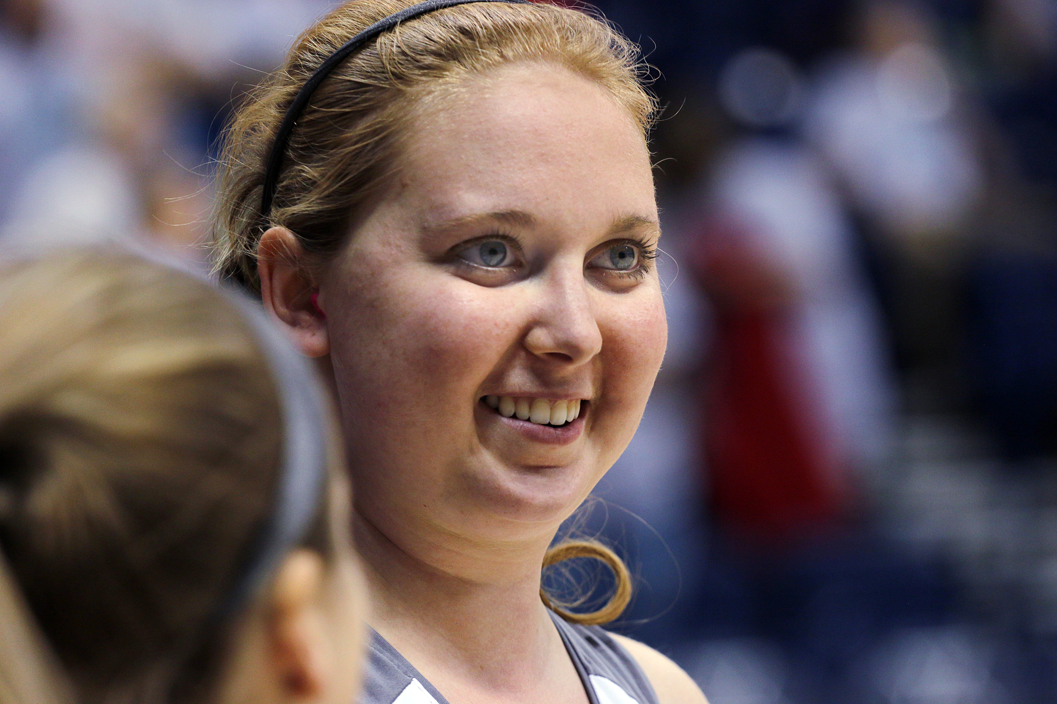 FILE - In this Nov. 2, 2014, file photo, Mount St. Joseph's Lauren Hill laughs with a teammate before her first NCAA college basketball game, against Hiram University, at Xavier University in Cincinnati. The 19-year-old freshman basketball player died at