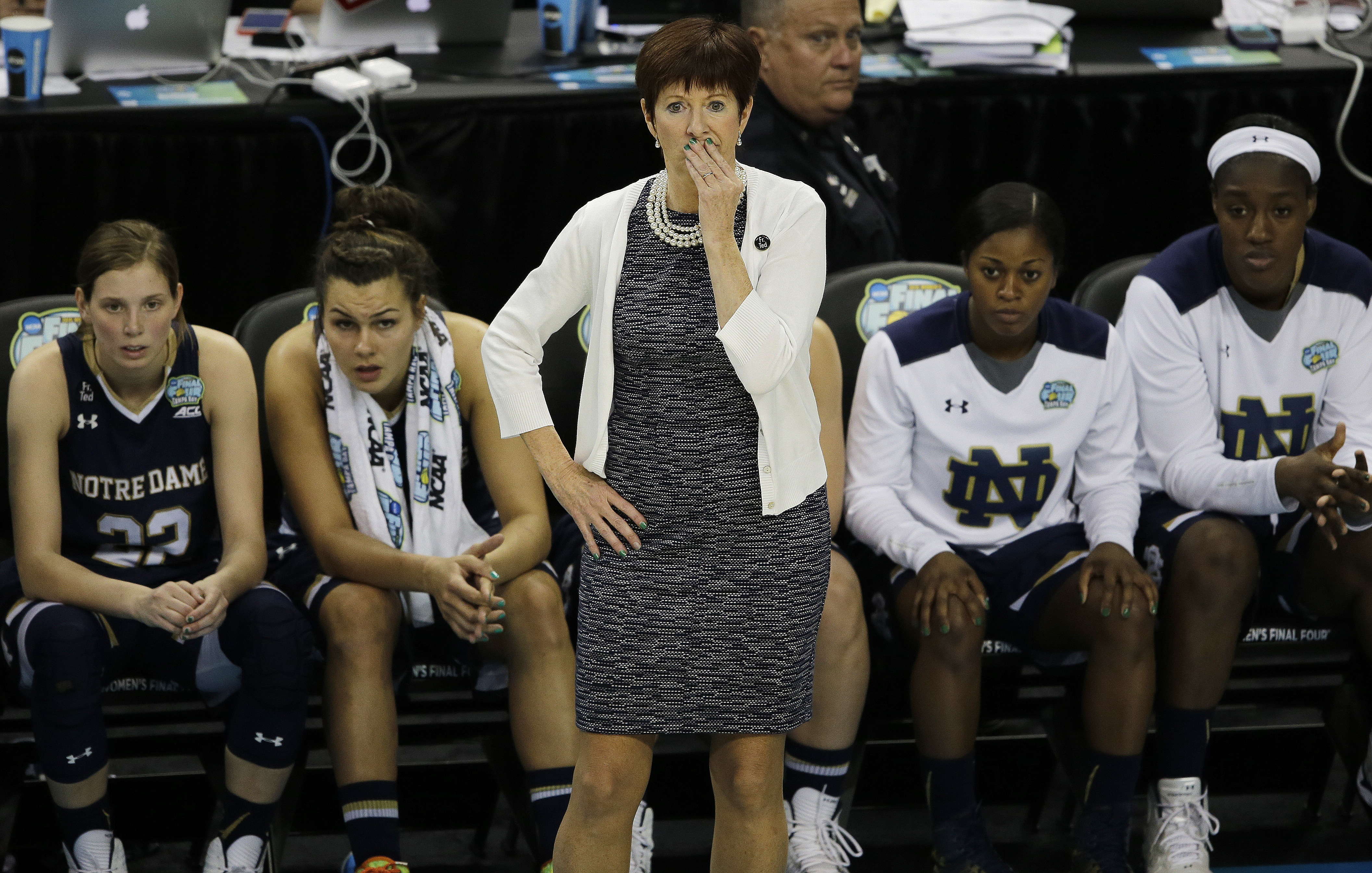 Notre Dame head coach Muffet McGraw watches play against Connecticut during the first half of the NCAA women's Final Four tournament college basketball championship game, Tuesday, April 7, 2015, in Tampa, Fla. (AP Photo/Chris O'Meara)