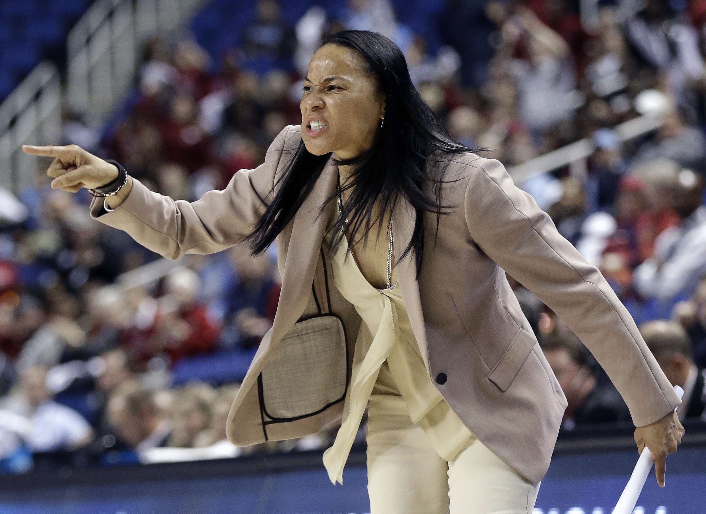 FILE - In this March 27, 2015, file photo, South Carolina coach Dawn Staley directs her team during the first half of a women's college basketball regional semifinal game against North Carolina in the NCAA Tournament Greensboro, N.C. Staley and No. 2 Sout