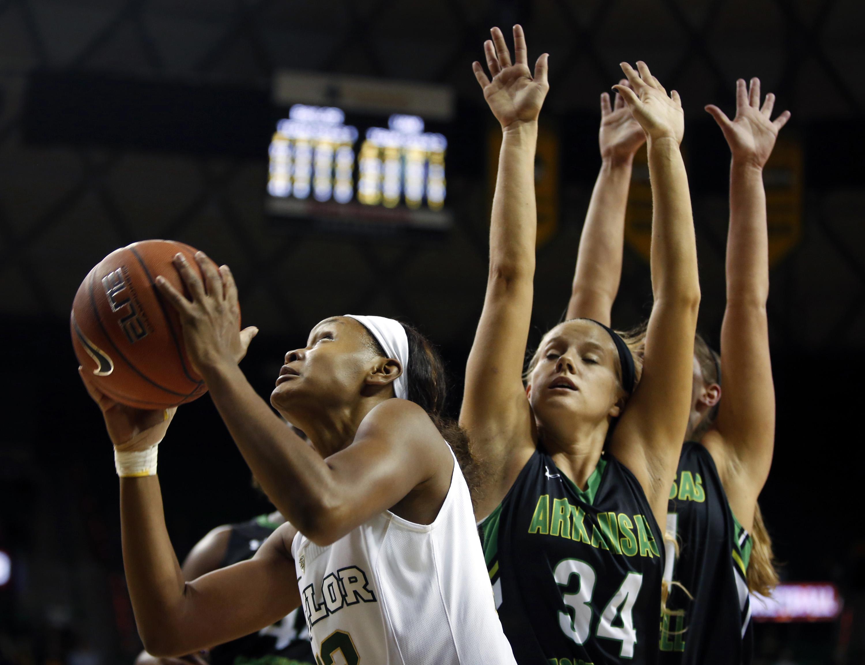 Baylor forward Nina Davis,left, drive past Arkansas-Monticello Nikki Mullen,right, in the first half of an NCAA college exhibition game, Monday, Nov. 9, 2015 in Waco, Texas. (Rod Aydelotte/Waco Tribune Herald, via AP)