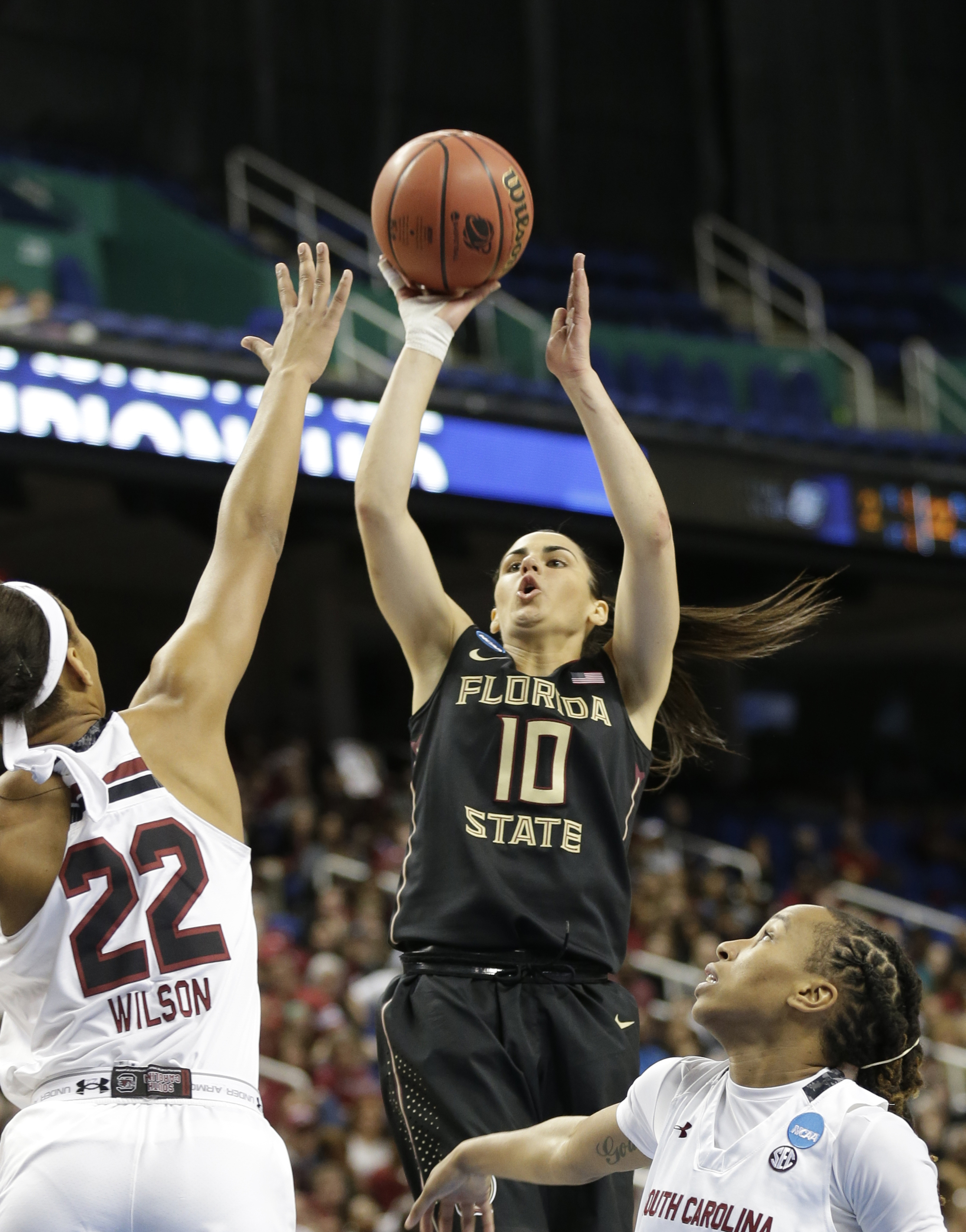 FILE - In this March 29, 2015, file photo, South Carolina's A'ja Wilson (22) and Olivia Gaines (2) defend as Florida State's Leticia Romero (10) shoots during the first half of a women's college basketball regional final game in the NCAA Tournament in Gre