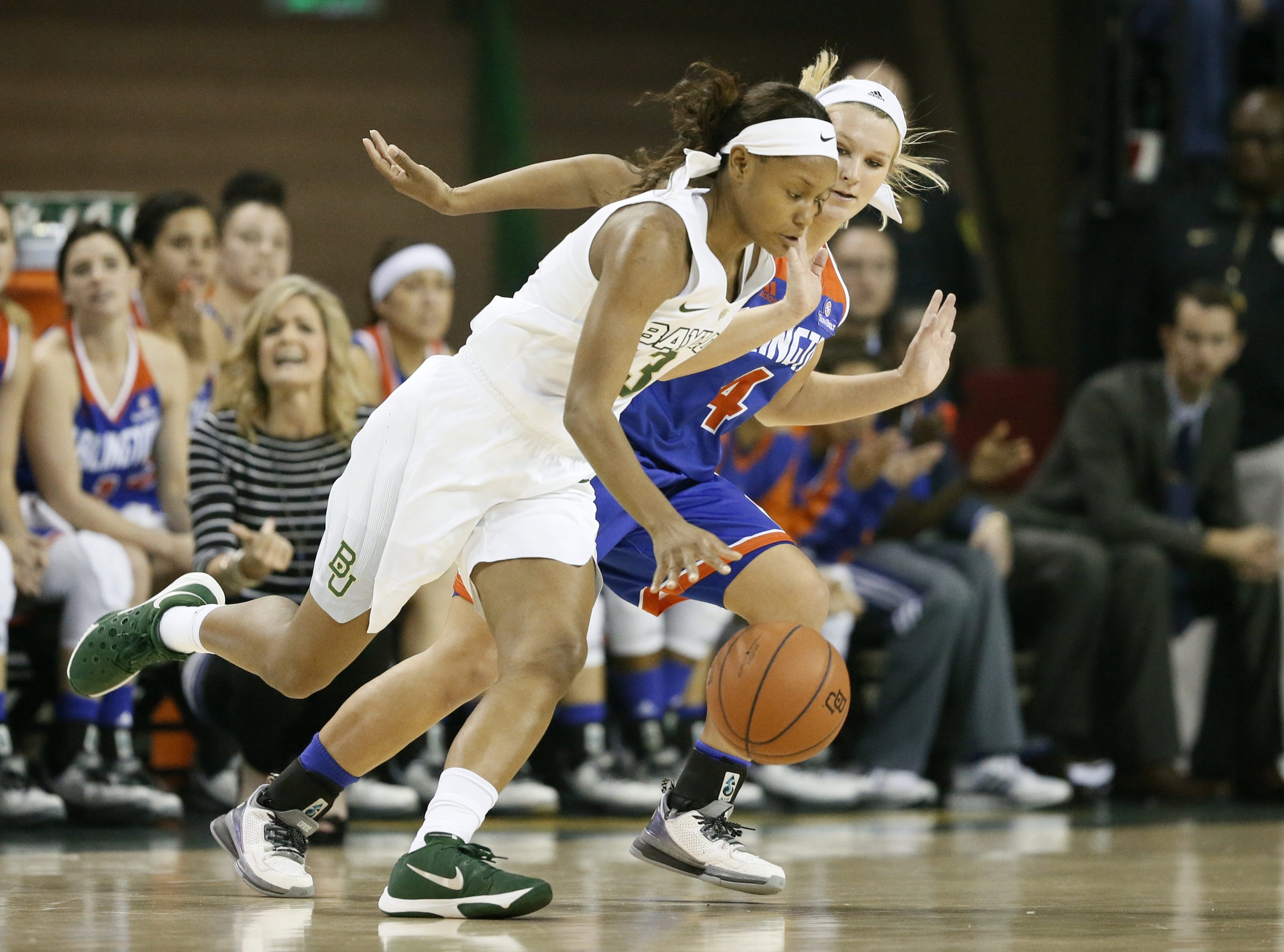 Baylor forward Nina Davis (13) moves the ball against Texas-Arlington guard Breck Clark, rear, in the first half of an NCAA college basketball game Friday, Nov. 13, 2015, in Waco, Texas. (AP Photo/Tony Gutierrez)