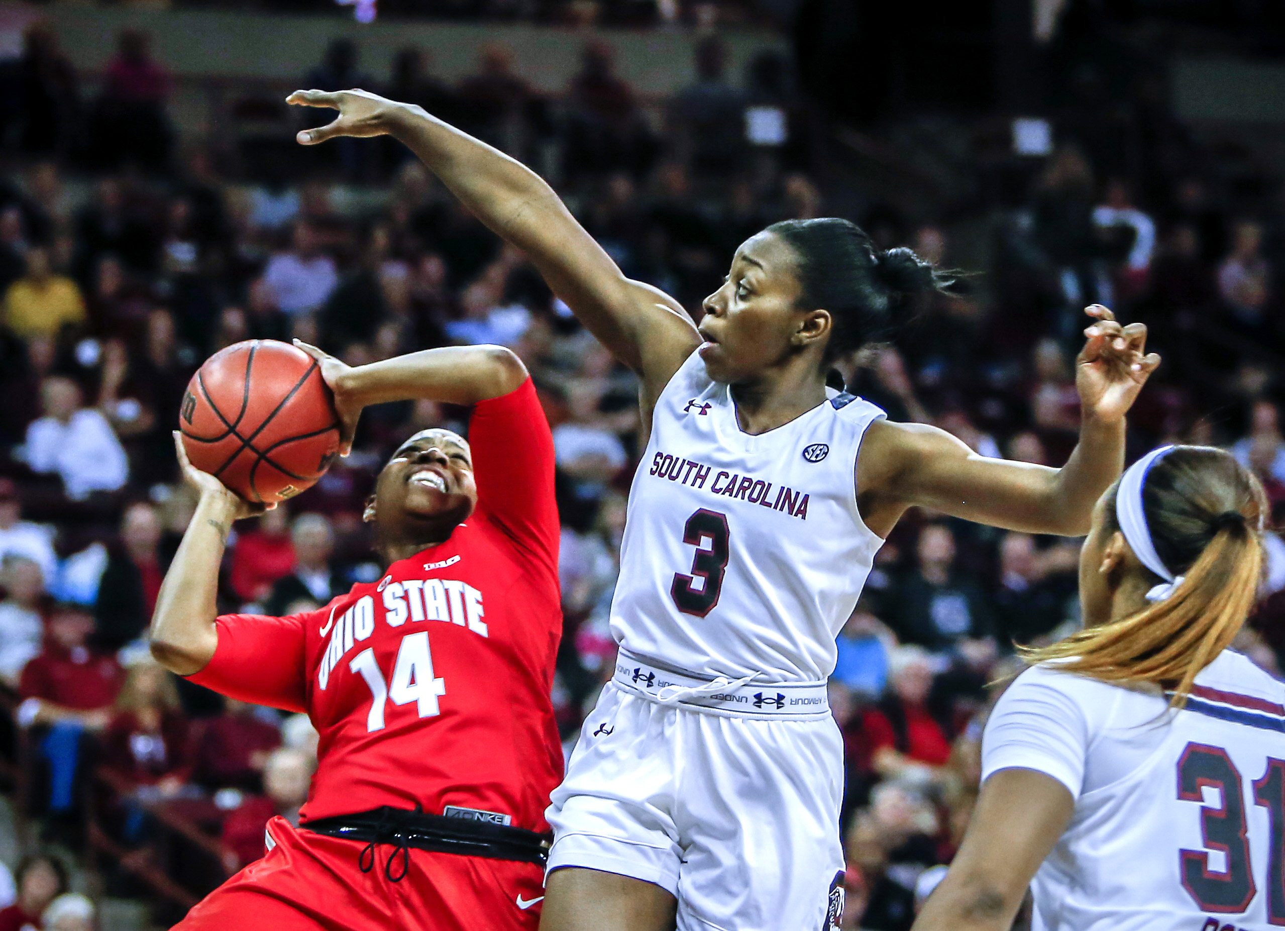 South Carolina guard Khadijah Sessions (5) defends Ohio State guard Ameryst Alston (14) during the first half of an NCAA college basketball game, Friday, Nov. 13, 2015, in Columbia, S.C. (AP Photo/Stephen B. Morton)