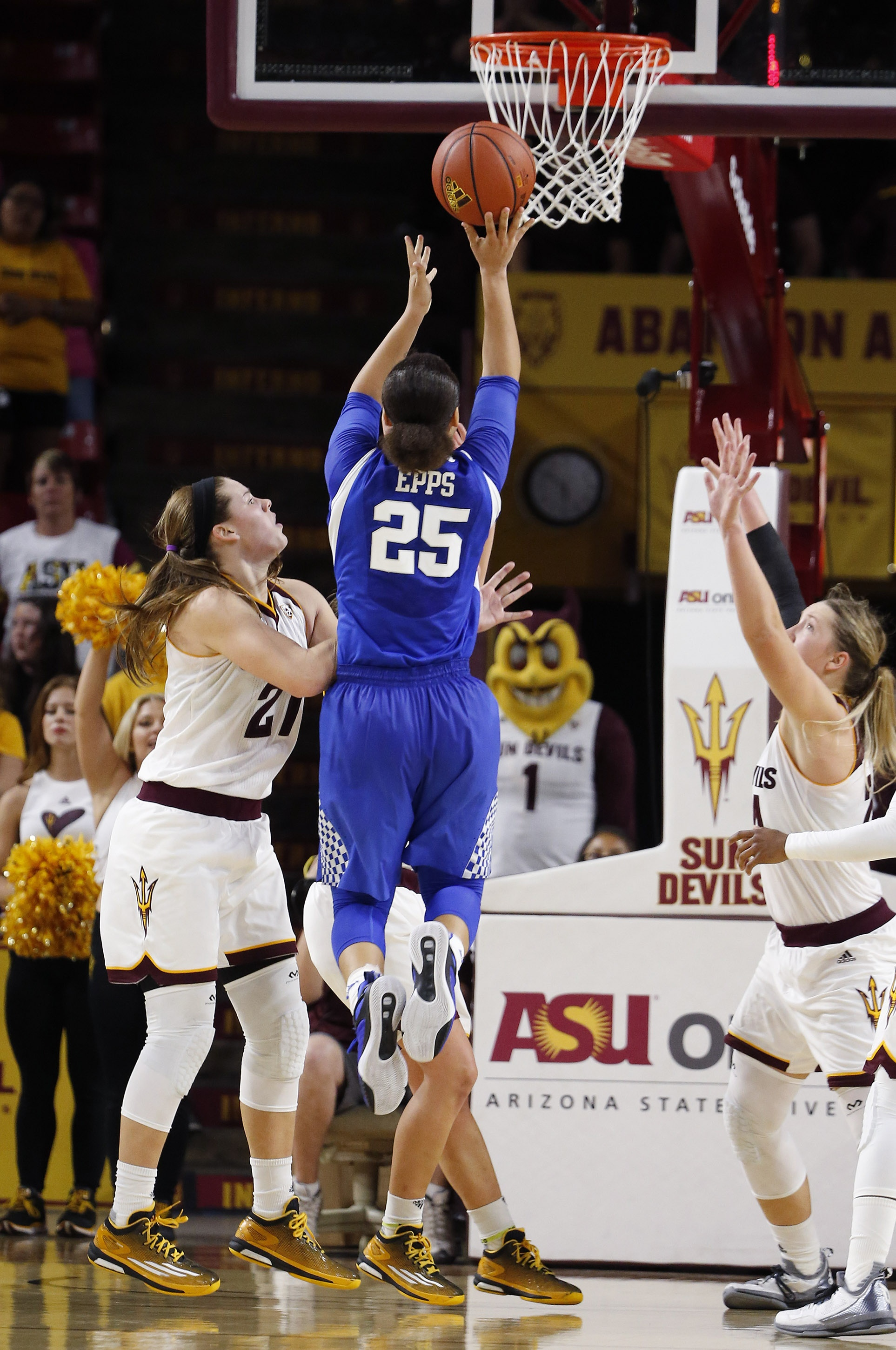 Kentucky's Makayla Epps (25) gets off a shot between Arizona State's Sophie Brunner (21) and Kelsey Moos, right, during overtime of an NCAA women's college basketball game Sunday, Nov. 15, 2015, in Tempe, Ariz. Kentucky defeated Arizona State 68-64 in ove