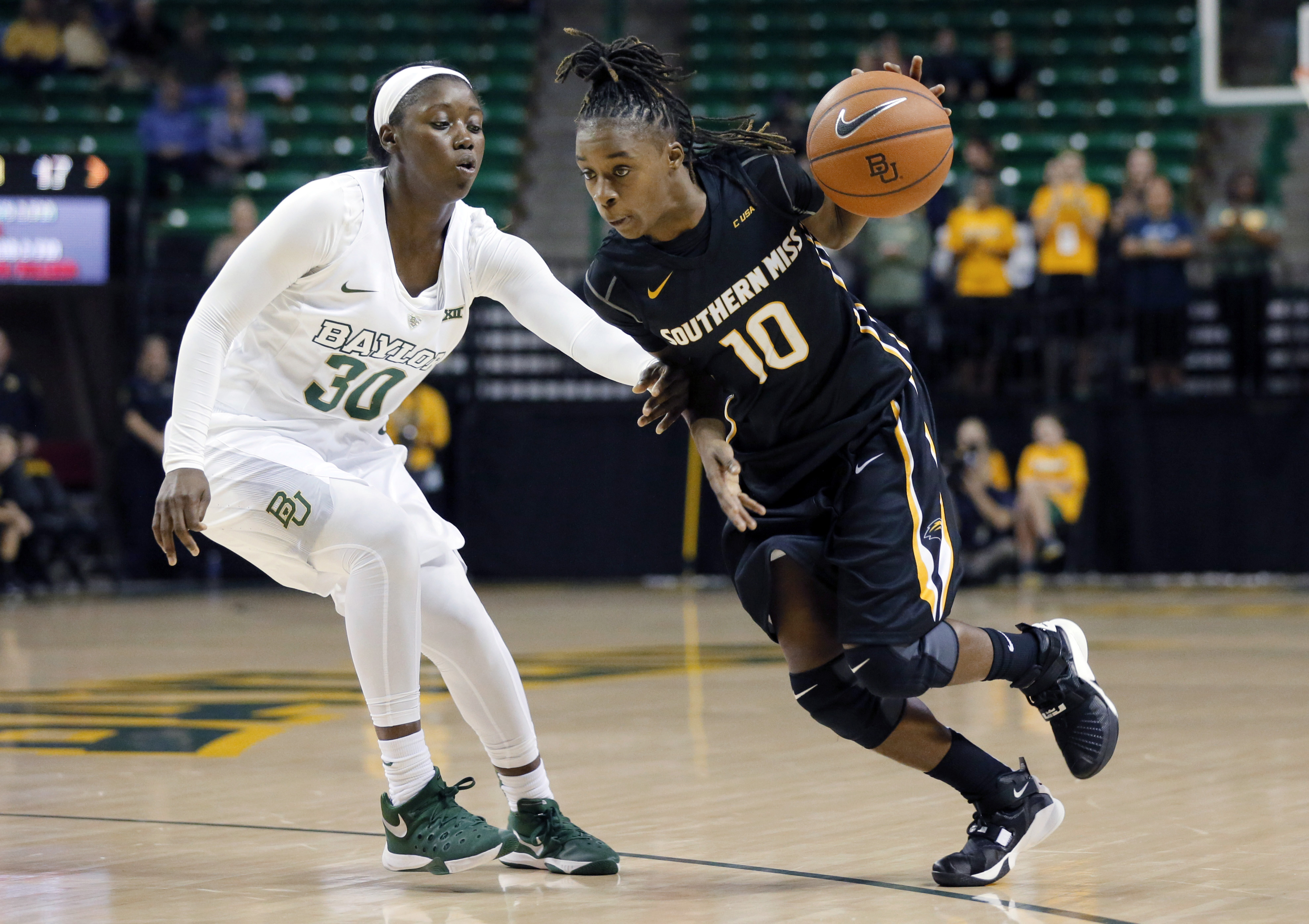 Baylor's Alexis Jones (30) defends as Southern Miss guard Jerontay Clemons (10) drives to the basket in the second quarter of an NCAA college basketball game, Monday, Nov. 16, 2015, in Waco, Texas. (AP Photo/Tony Gutierrez)