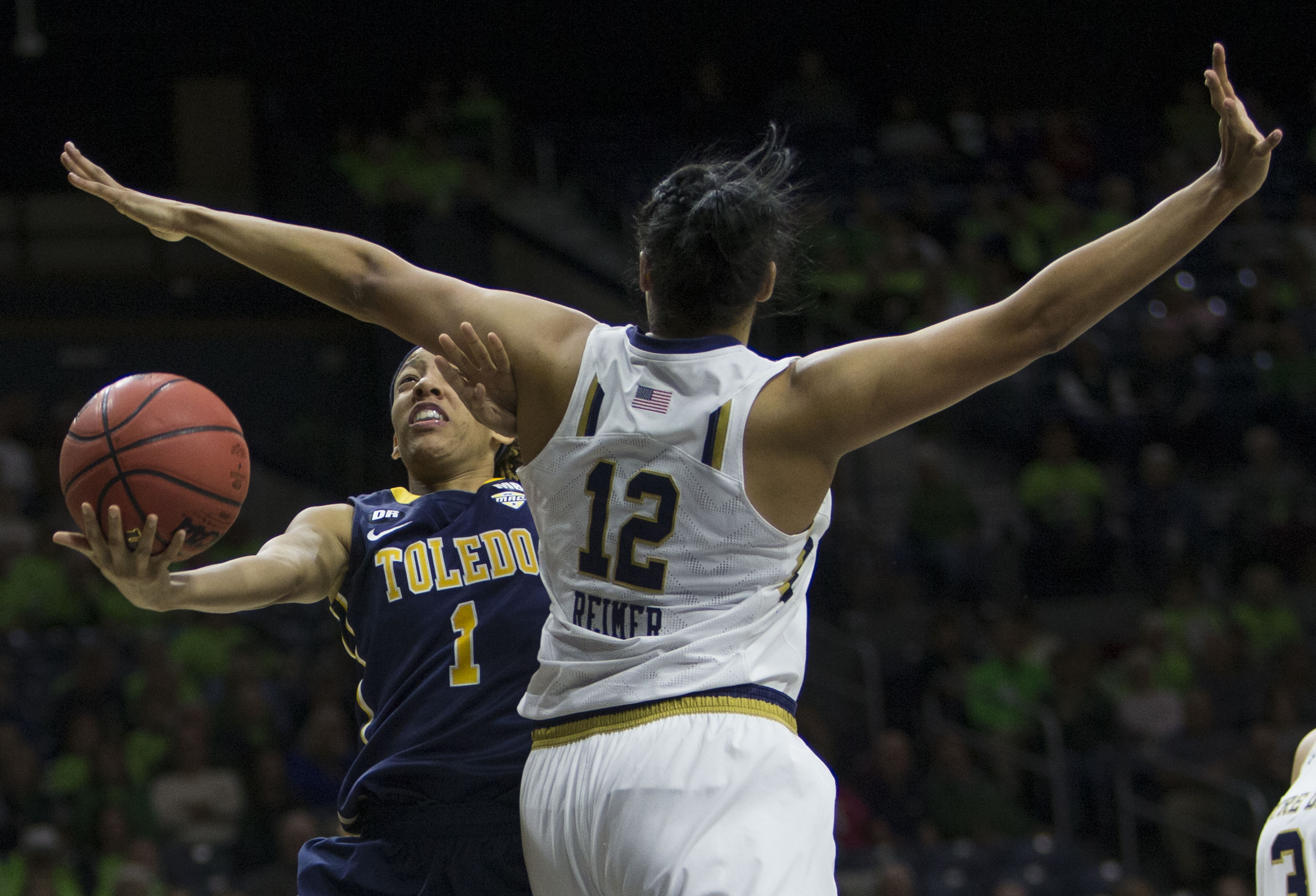 Toledo's BrenaeHarris (1) goes up for a shot as Notre Dame's Taya Reimer (12) defends in the first half of an NCAA college basketball game in South Bend, Ind., Wednesday, Nov. 18, 2015.  (AP Photo/Robert Franklin)