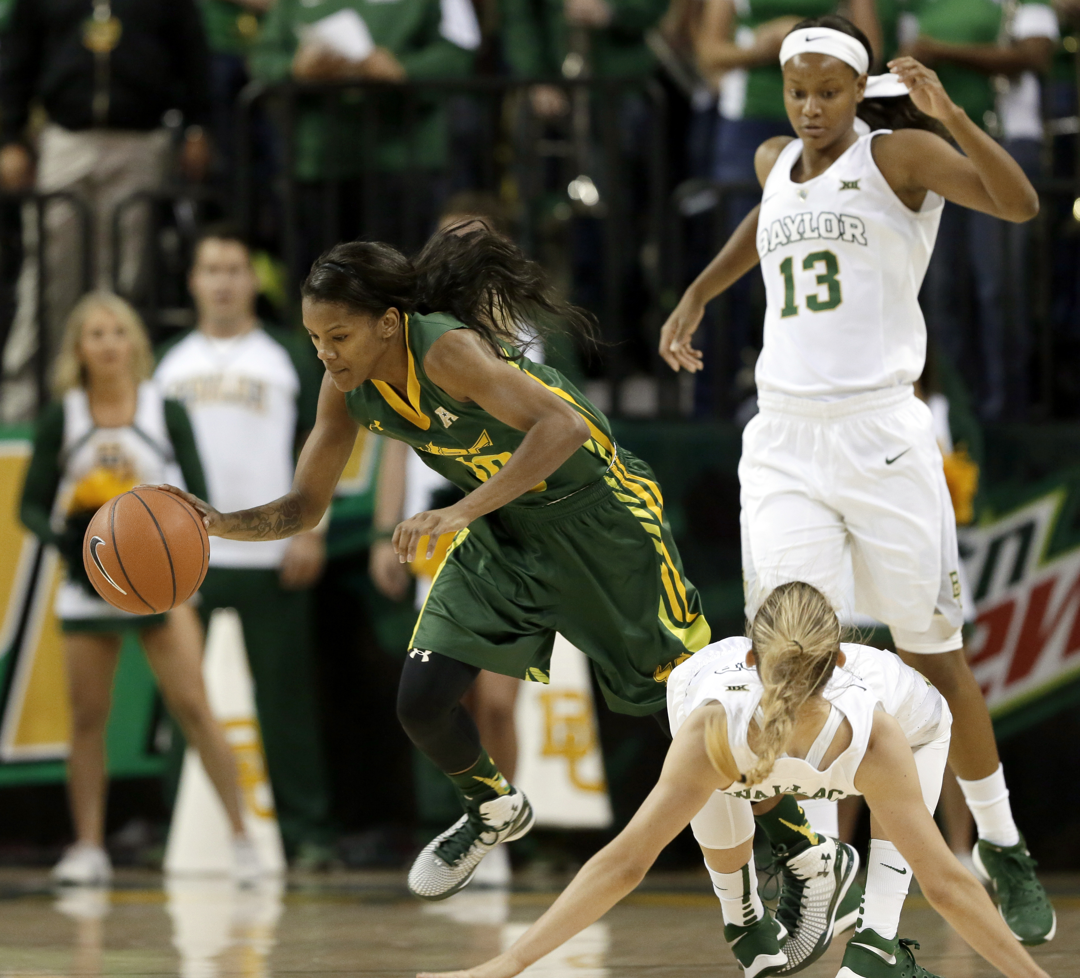 South Florida's Courtney Williams (10) collides with Baylor's Kristy Wallace, ending her to the floor as Williams moves the ball up the court during the first half of an NCAA college basketball game, Thursday, Nov. 19, 2015, in Waco, Texas. Baylor's Nina