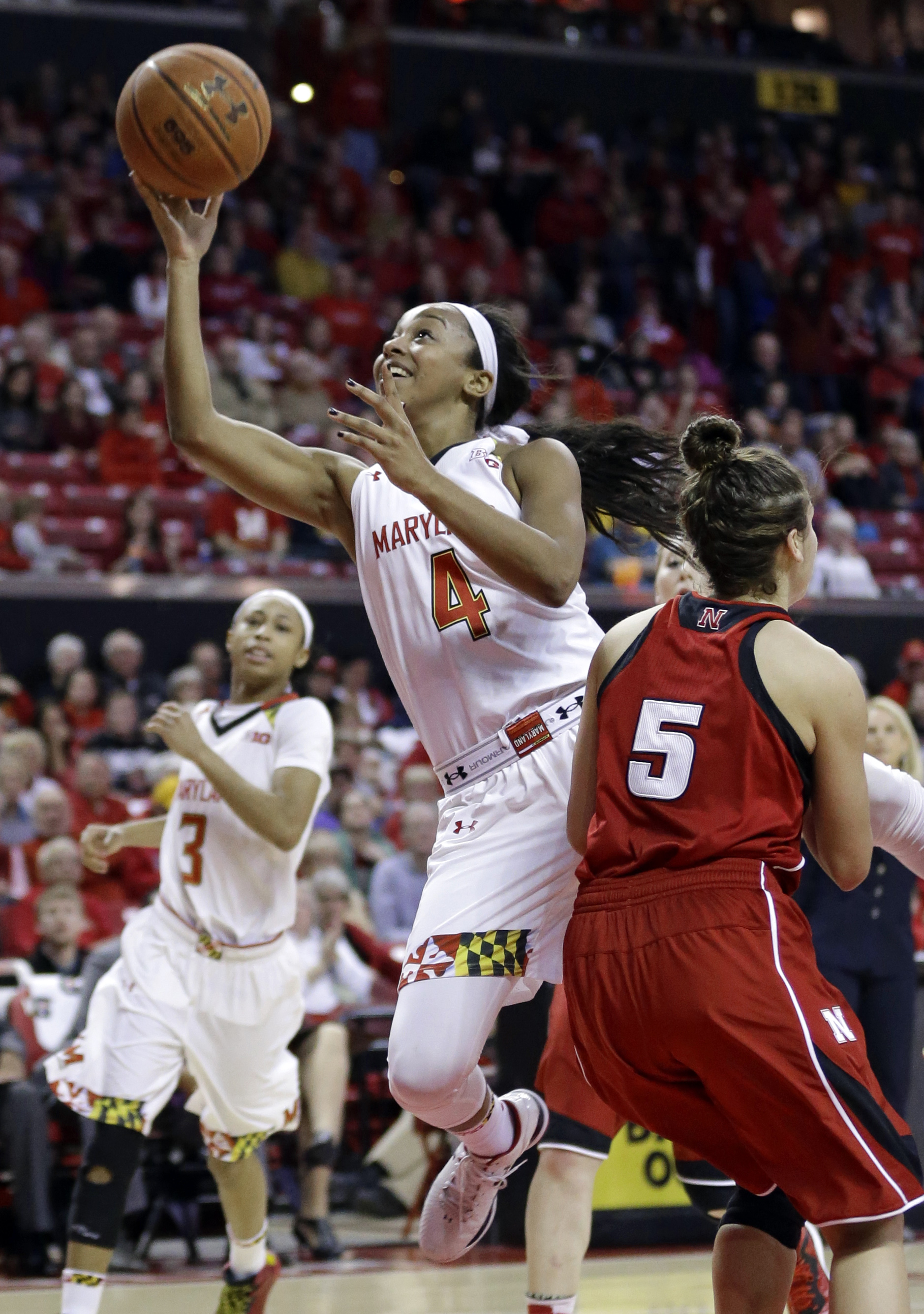 FILE - In this Feb. 8, 2015, file photo, Maryland guard Lexie Brown (4) shoots over Nebraska guard Natalie Romeo in the second half of an NCAA college basketball game in College Park, Md. Lexie Brown is settling in at Duke, and the school has decided to m