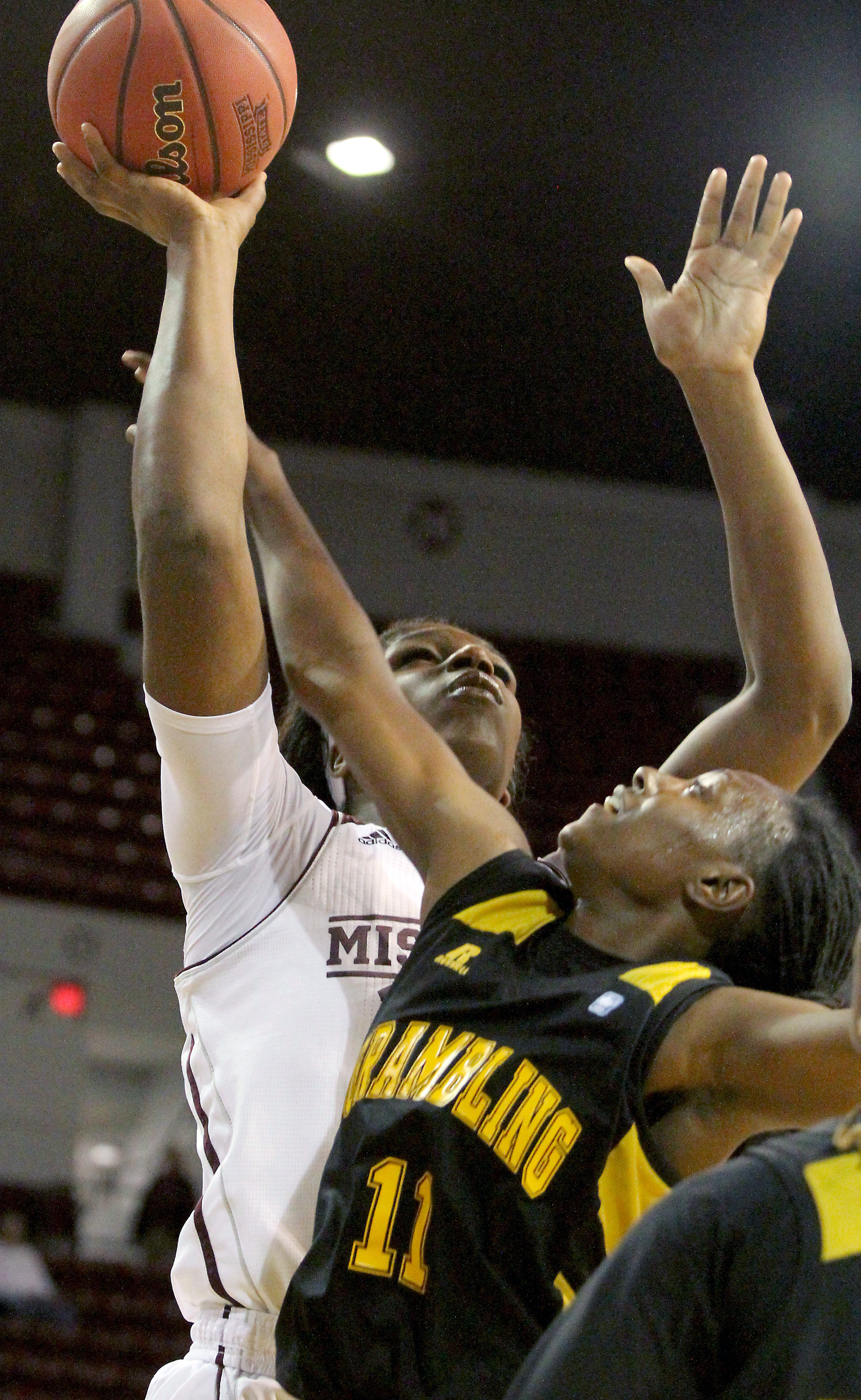 Mississippi State center Teaira McCowan (15) is fouled while shooting by Grambling State guard Chantiara Lewis (11) during the first half of an NCAA college basketball game in Starkville, Miss., Saturday, Nov. 21, 2015. (AP Photo/Jim Lytle)