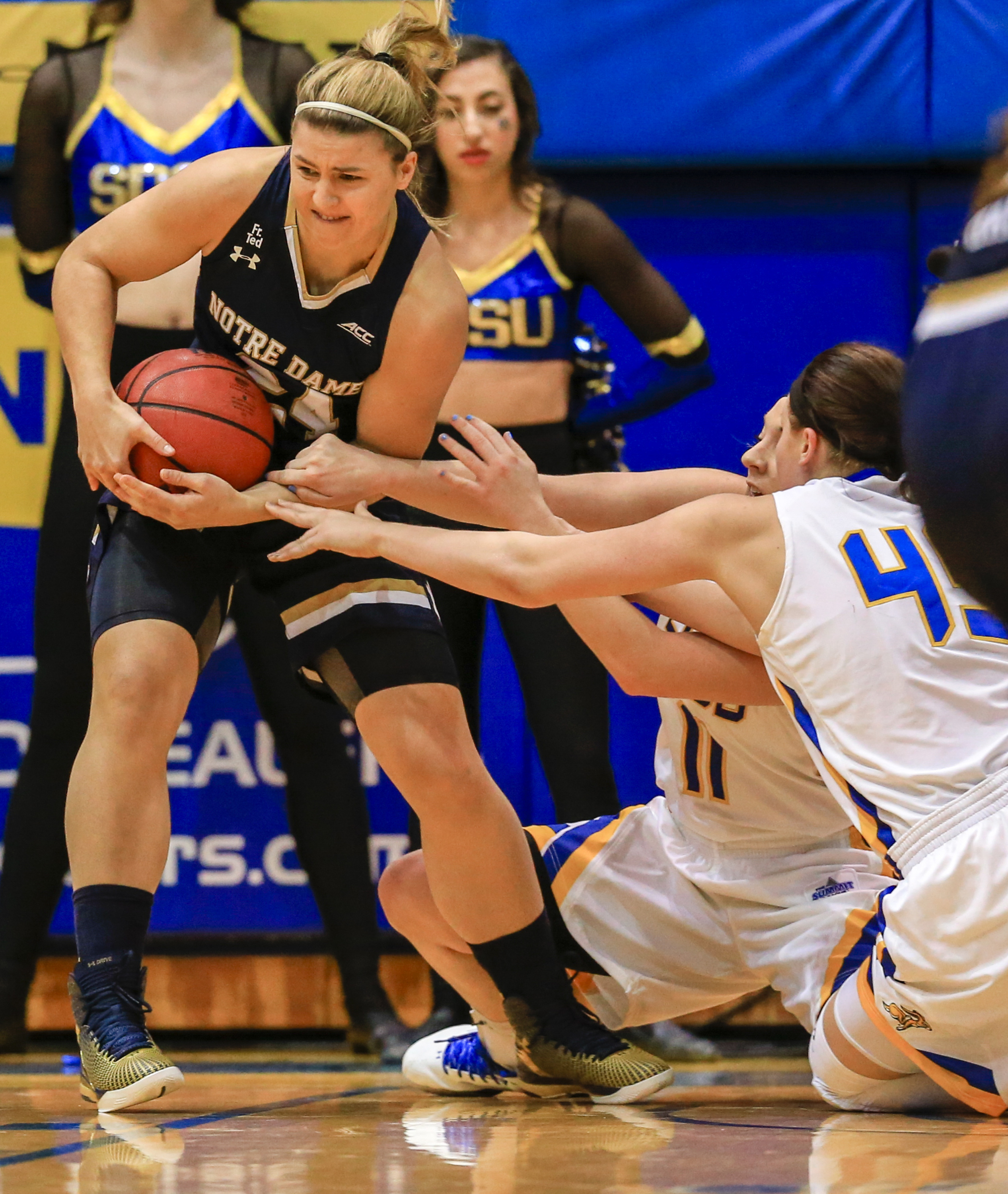 Notre Dame guard Hannah Huffman (24) grabsthe ball away from South Dakota State guard Gabrielle Boever (4)5 and Madison Guebert (11) during the first half of an NCAA college basketball game in Brookings, S.D., Saturday, Nov. 21, 2015. (AP Photo/Nati Harni