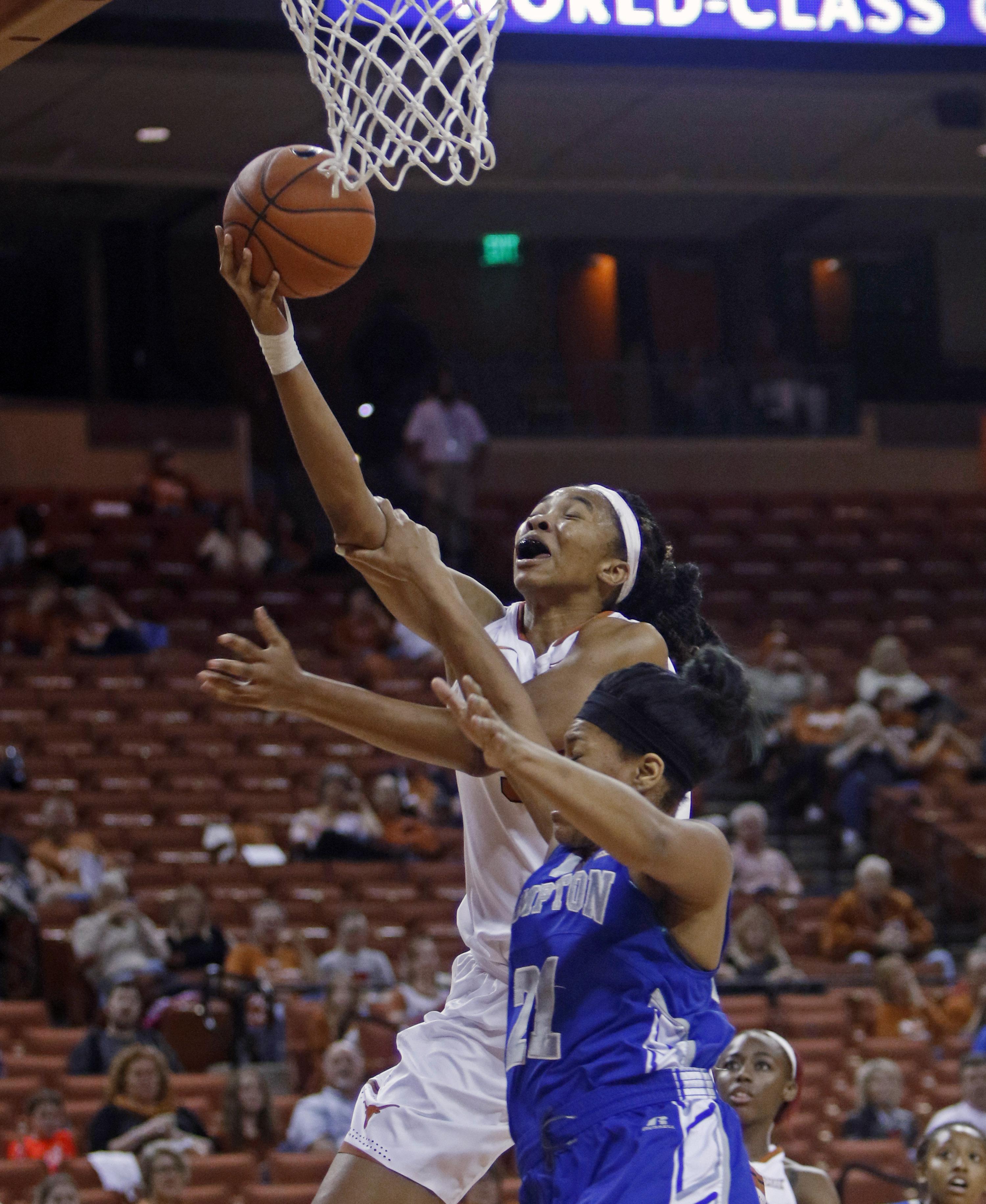 Texas center Imani Boyette shoots against Hampton forward Mikayla Sayle, during the second half of an NCAA college basketball game Wednesday, Nov. 25, 2015, in Austin, Texas. Texas won 79-52. (AP Photo/Michael Thomas)
