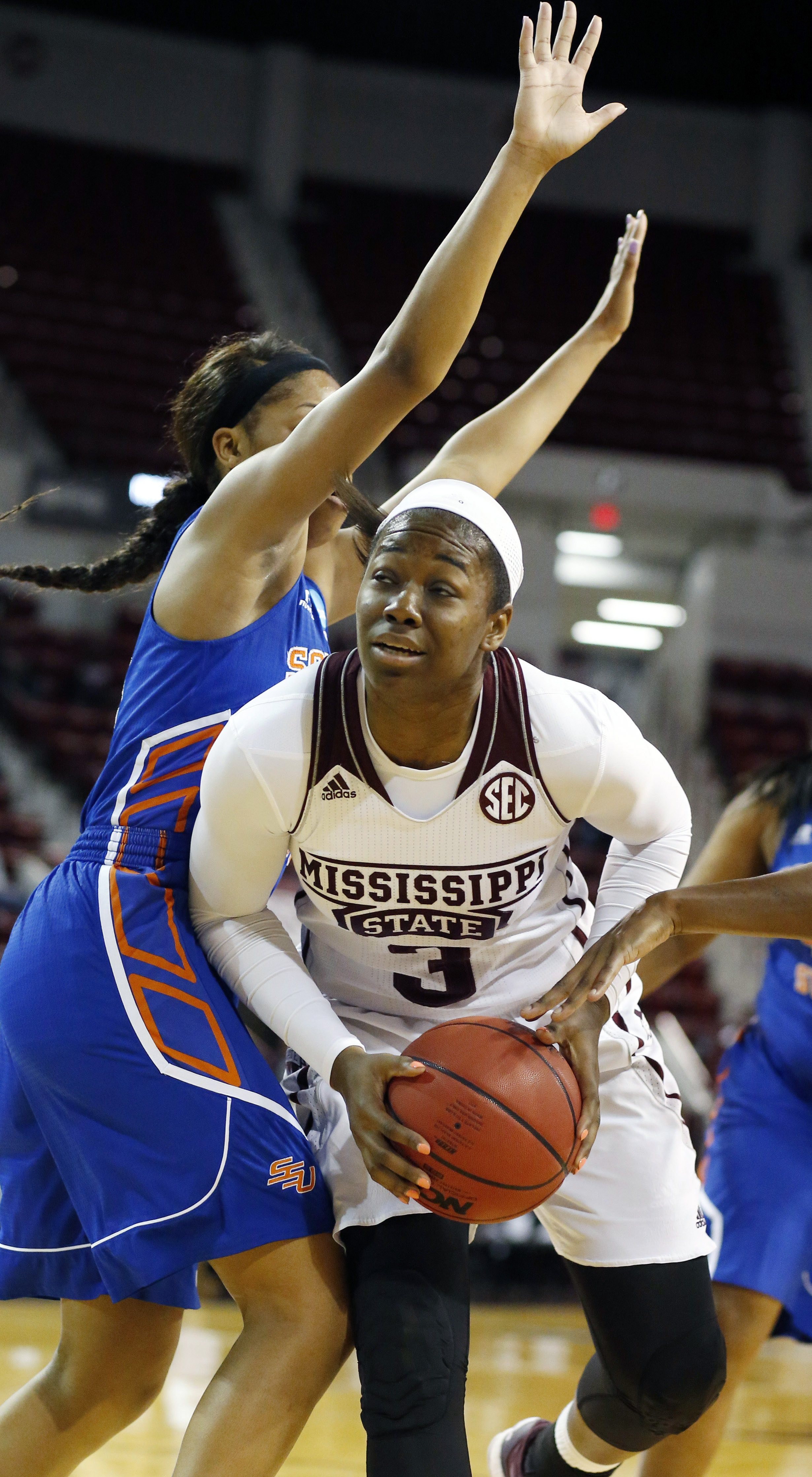 Mississippi State forward Breanna Richardson (3) looks for someone to pass to as a Savannah State player defends in the first half of an NCAA college basketball game in Starkville, Miss., Sunday, Nov. 29, 2015. (AP Photo/Rogelio V. Solis)