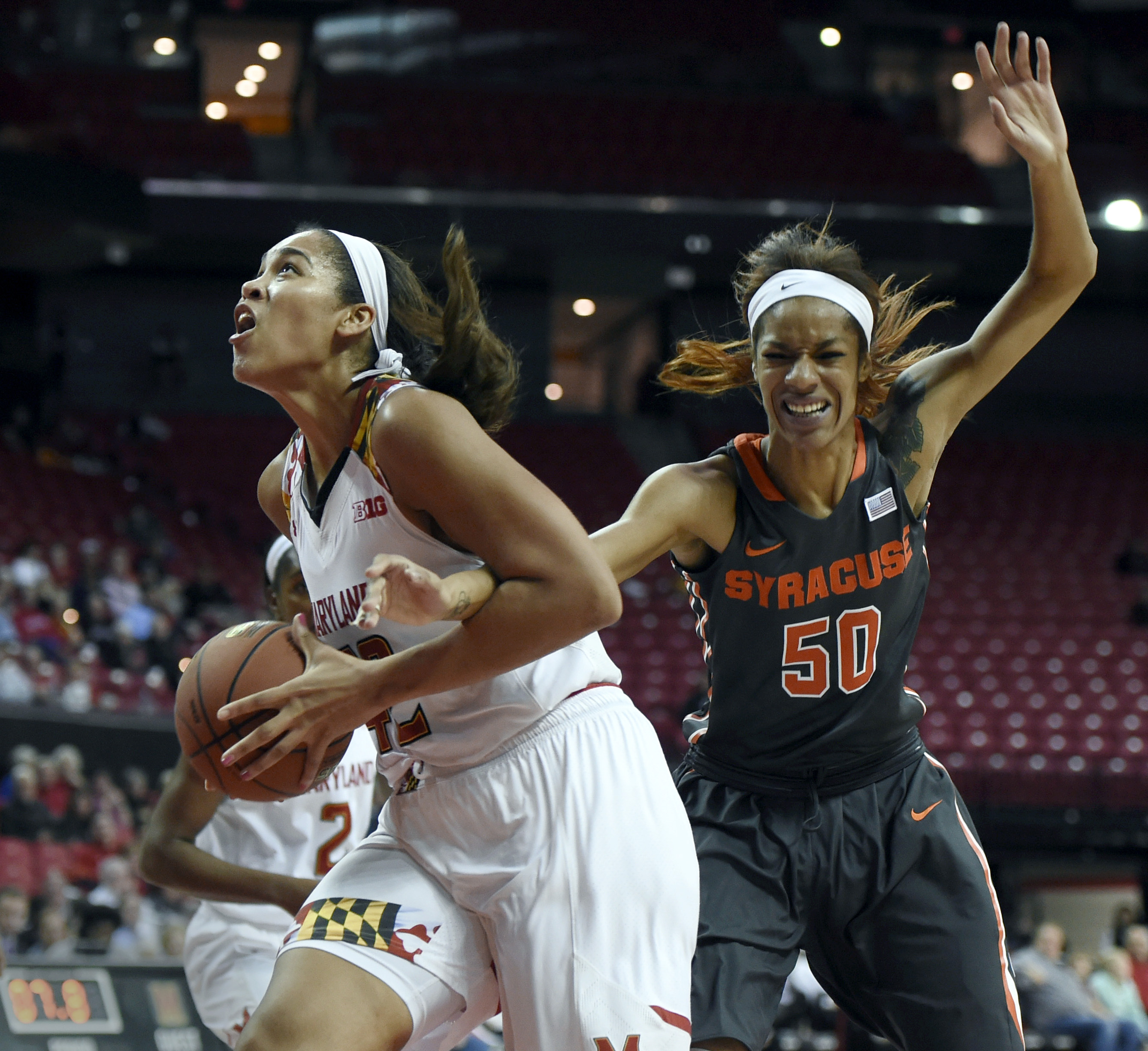 Maryland's Brionna Jones, left, drives to the basket as Syracuse's Briana Day defends in the first half of an NCAA college basketball game, Wednesday, Dec. 2, 2015, in College Park, Md. (AP Photo/Gail Burton)
