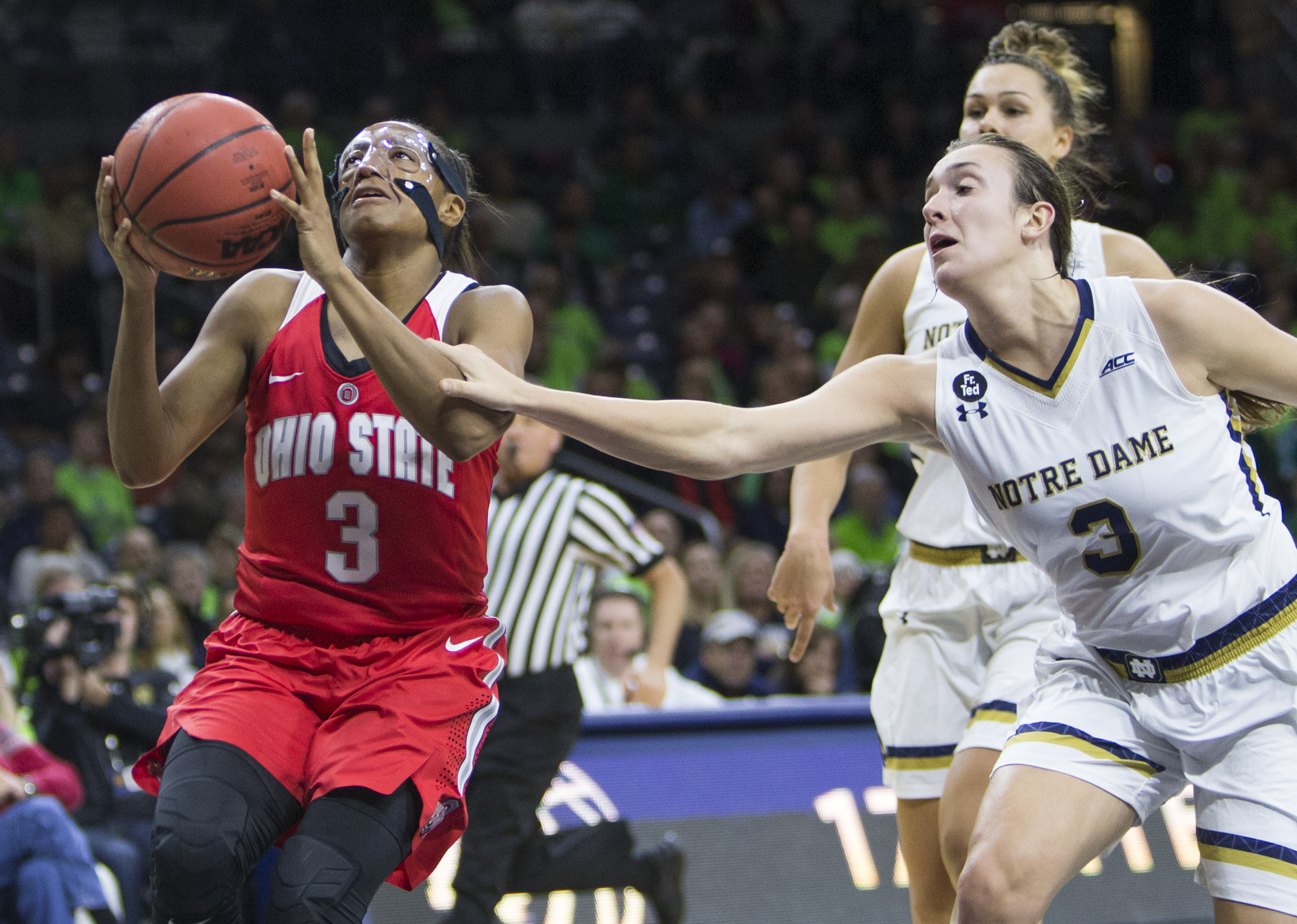 Notre Dame's Marina Mabrey, right, fouls Ohio State's Kelsey Mitchell (3) under the basket during the first half of an NCAA college basketball game on Wednesday, Dec. 2, 2015, in South Bend, Ind.  (AP Photo/Robert Franklin)