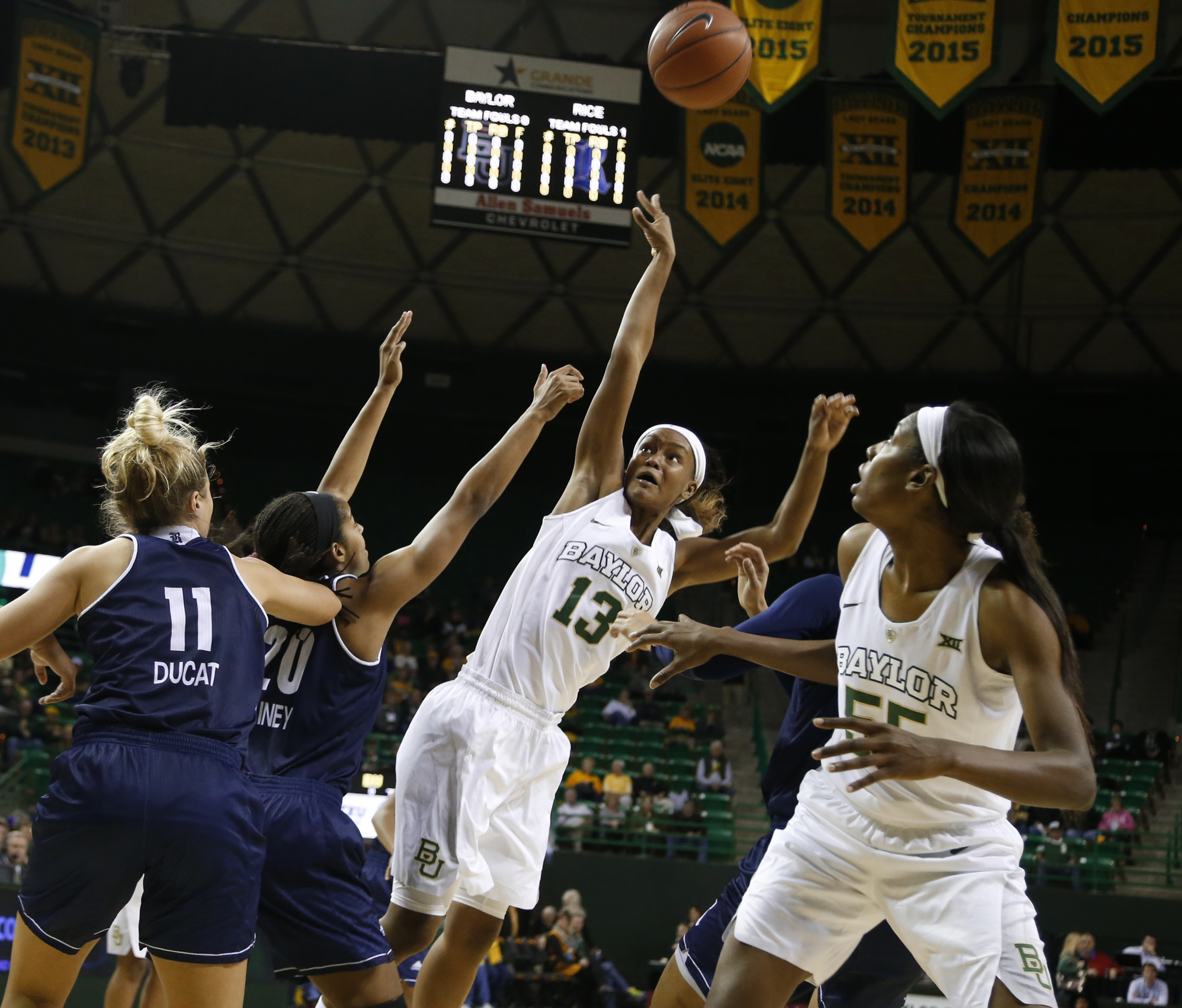 Baylor forward Nina Davis (13) attempts a shot over Rice guard Shani Rainey (20) during the first half of an NCAA college basketball game, Wednesday, Dec. 2, 2015, in Waco, Texas. Looking on are Rice forward Lexie Ducat (11) and Baylor forward/center Khad