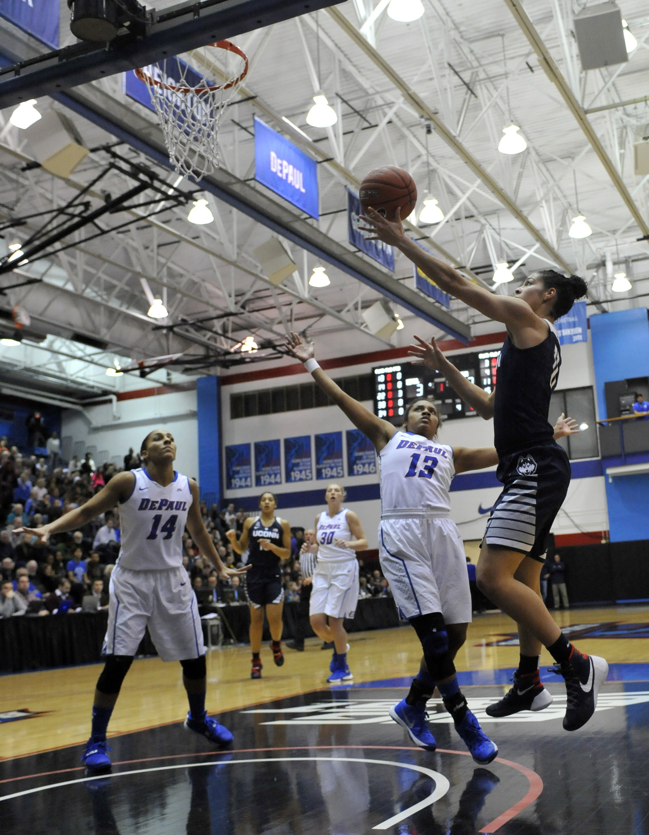 Connecticut's Kia Nurse (11) goes up for a shot against DePaul's Chanise Jenkins (13) during the first half of an NCAA college basketball game, Wednesday, Dec. 2, 2015, in Chicago. (AP Photo/Paul Beaty)