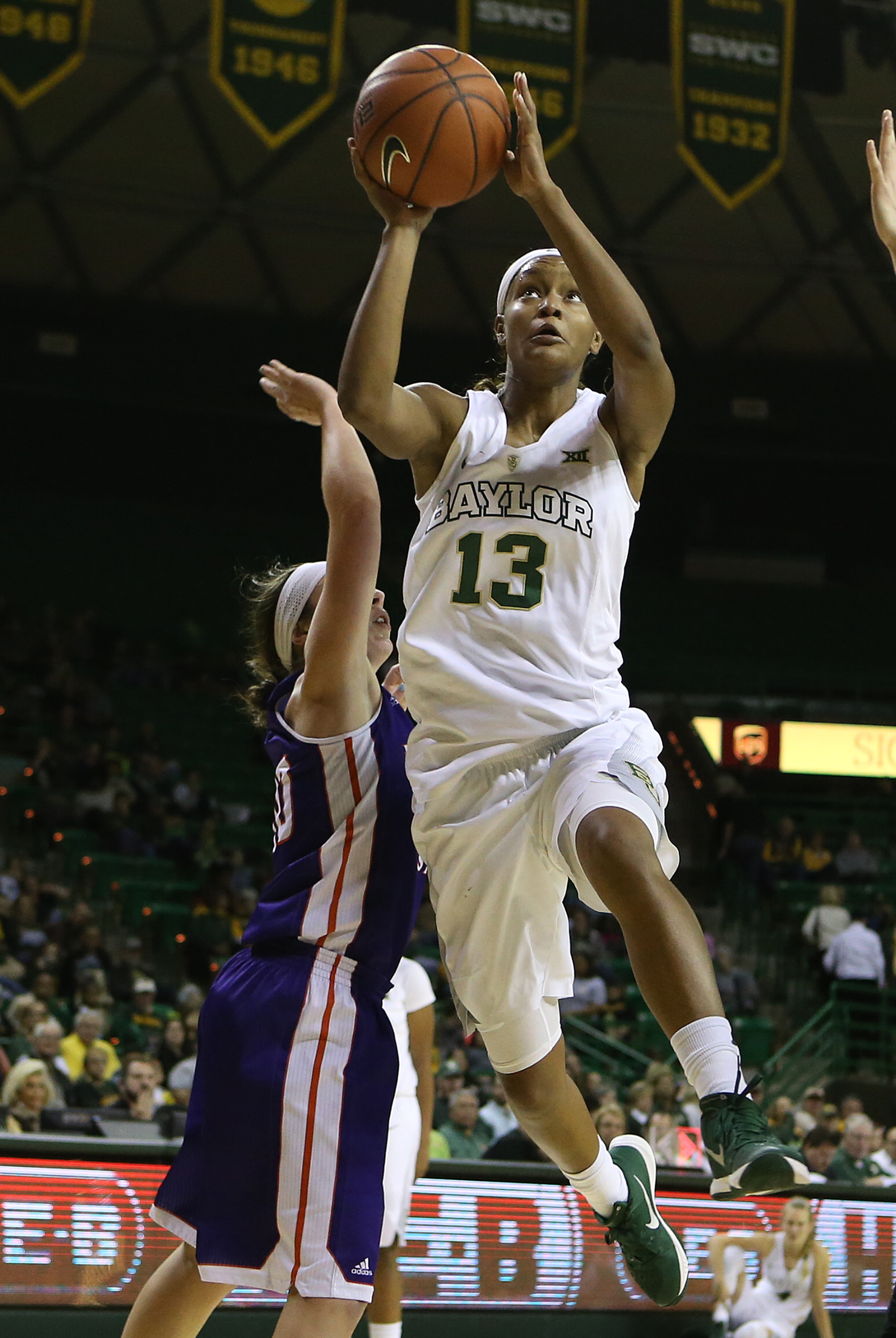 Baylor forward Nina Davis (13) shoots past Northwestern State forward Emerald Mayfield (00) in the second half of an NCAA college basketball game, Friday, Dec. 4, 2015, in Waco, Texas. (AP Photo/Jerry Larson)