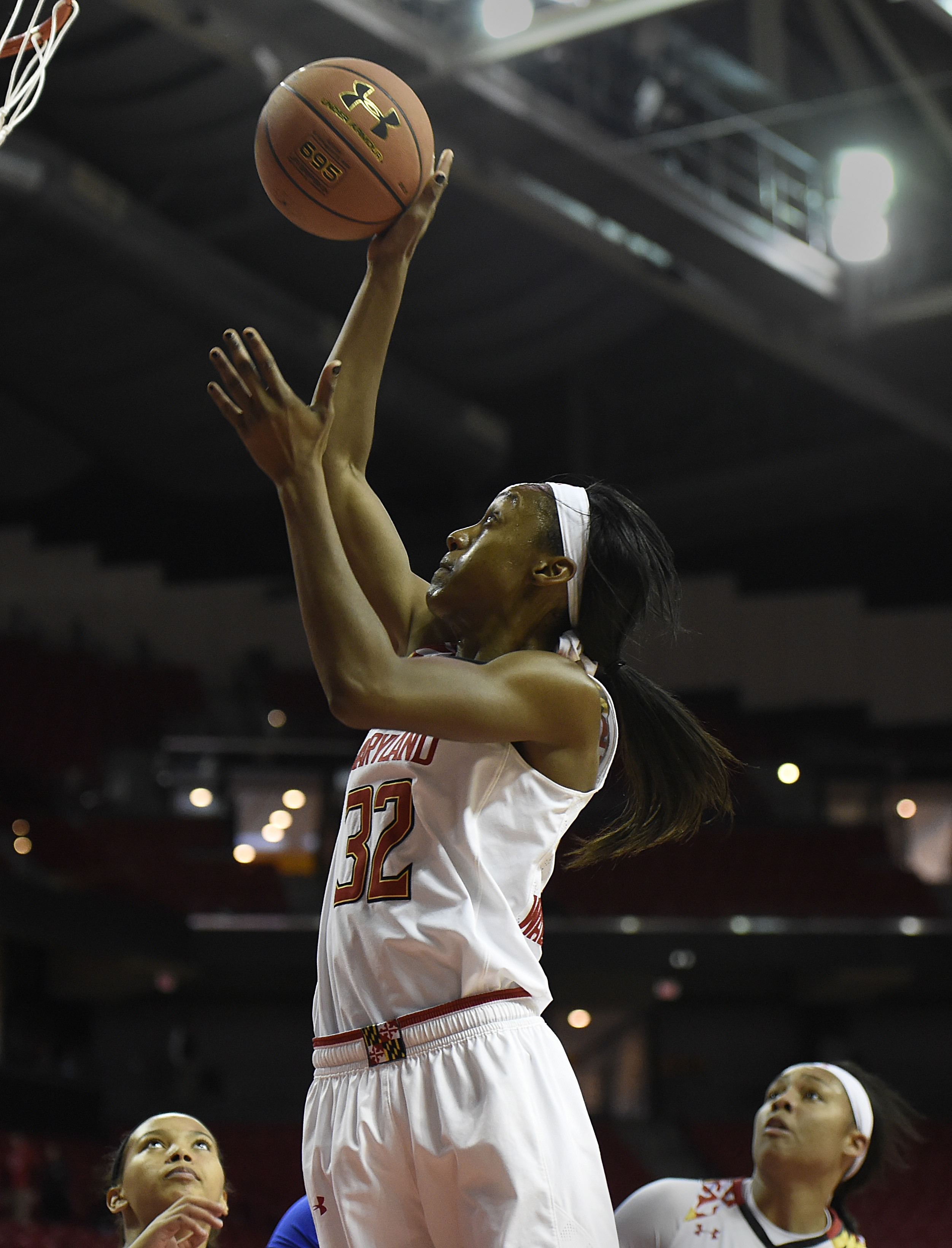Maryland's  Shatori Walker-Kimbrough scores against Central Connecticut State in the first half of an NCAA college basketball game, Saturday, Dec. 5, 2015, in College Park, Md. (AP Photo/Gail Burton)