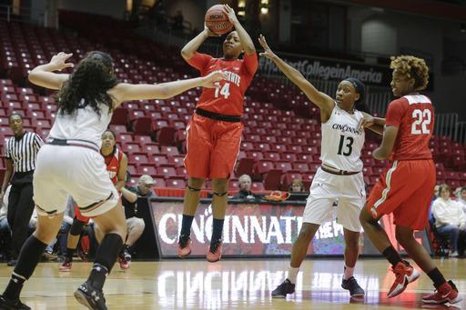 Ohio State's Ameryst Alston (14) shoots against Cincinnati's Brandey Tarver (13) and Chelsea Warren, left, as Ohio's Alexa Hart (22) looks on in the first half of an NCAA college basketball game, Sunday, Dec. 6, 2015, in Cincinnati. (AP Photo/John Minchil