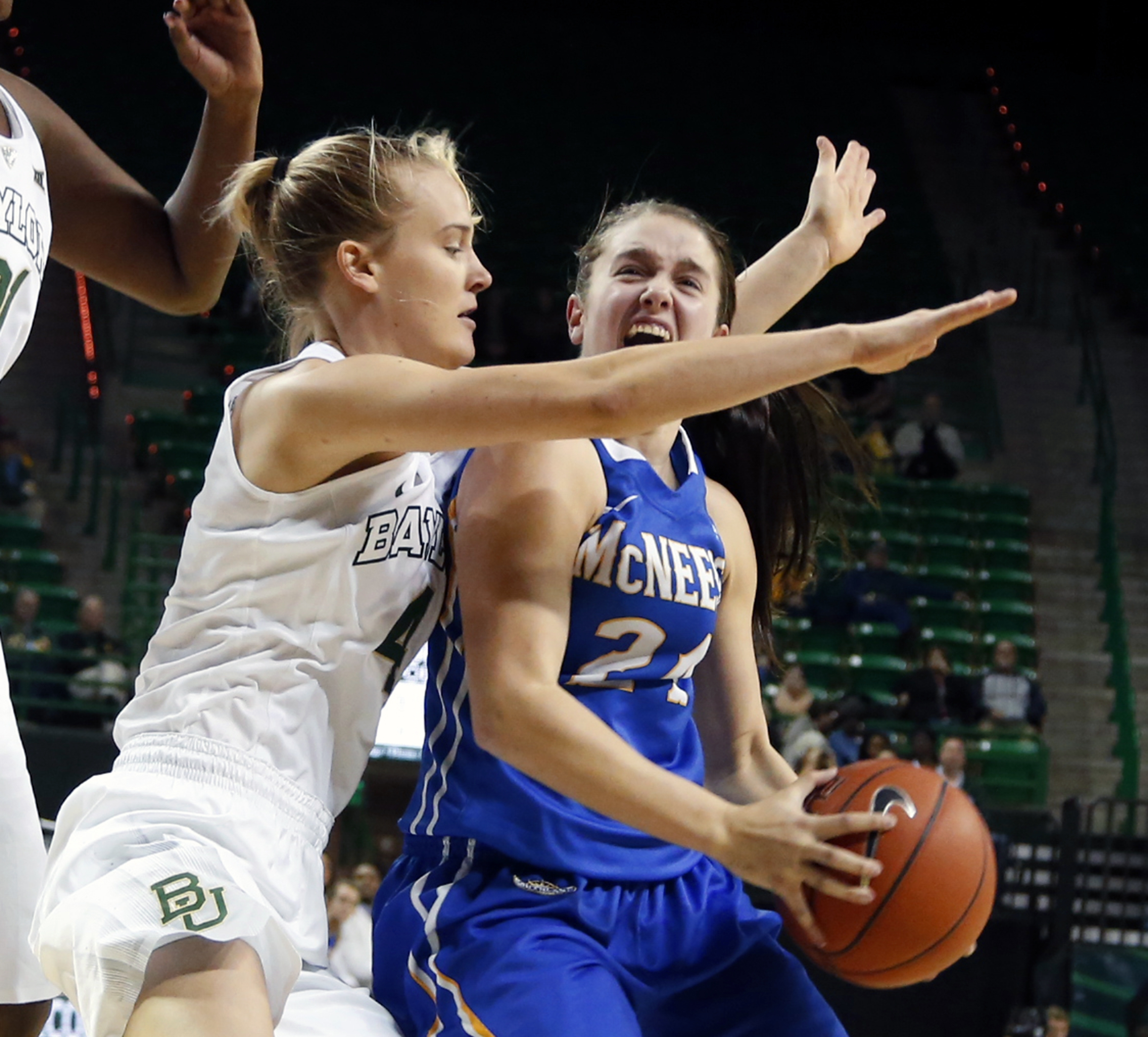 Baylor guard Kristy Wallace (4), left, guards McNeese State guard Haily Jenkins (24), right, in the first half of an NCAA college basketball game, Sunday, Dec. 13, 2015, in Waco, Texas. (AP Photo/Rod Aydelotte)