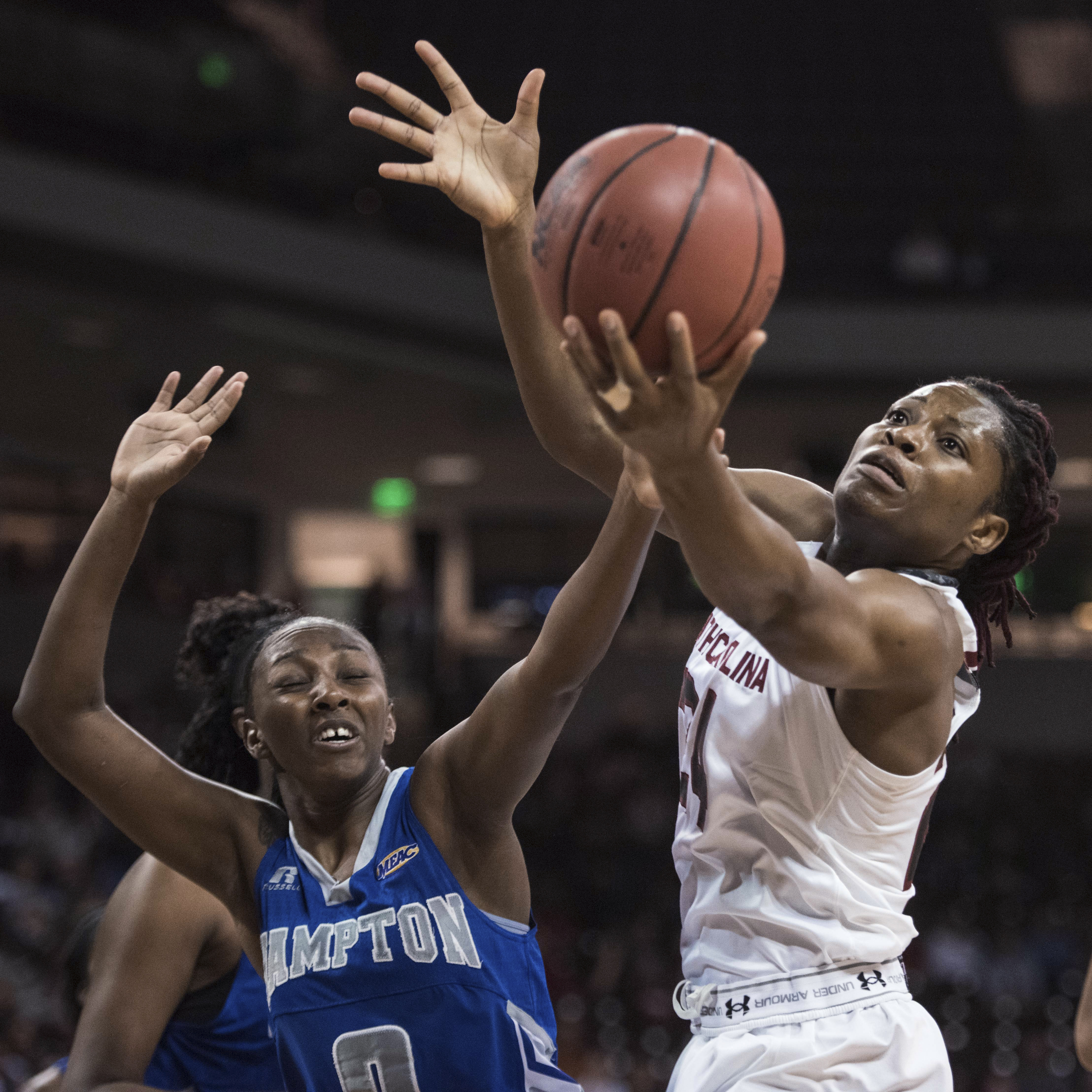 South Carolina forward Sarah Imovbioh, right, reaches for a rebound against Hampton guard Malia Tate-DeFreitas, left, during the first half of an NCAA college basketball game Wednesday, Dec. 16, 2015, in Columbia, S.C.  (AP Photo/Sean Rayford)