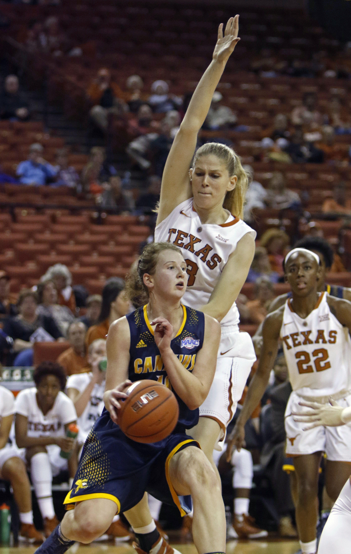 Canisius guard Margaret Halfdanardottir, front, drives the ball against Texas forward Sara Hattis during the first half of an NCAA college basketball game, Wednesday, Dec. 16, 2015, in Austin, Texas. (AP Photo/Michael Thomas)