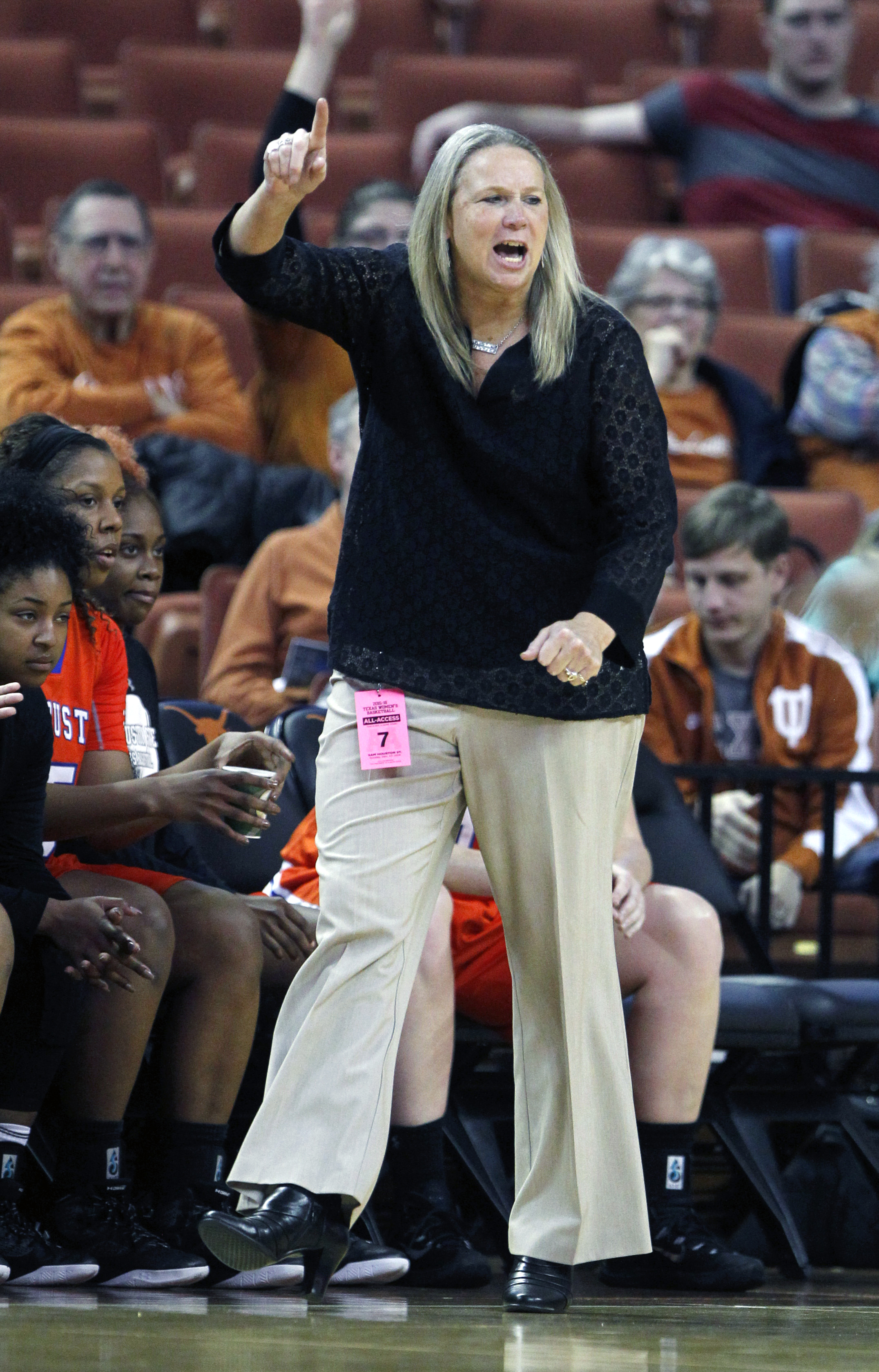 Sam Houston State coach Brenda Welch-Nichols calls to her team during the first half of an NCAA college basketball game against Texas, Sunday, Dec. 27, 2015, in Austin, Texas. (AP Photo/Michael Thomas)