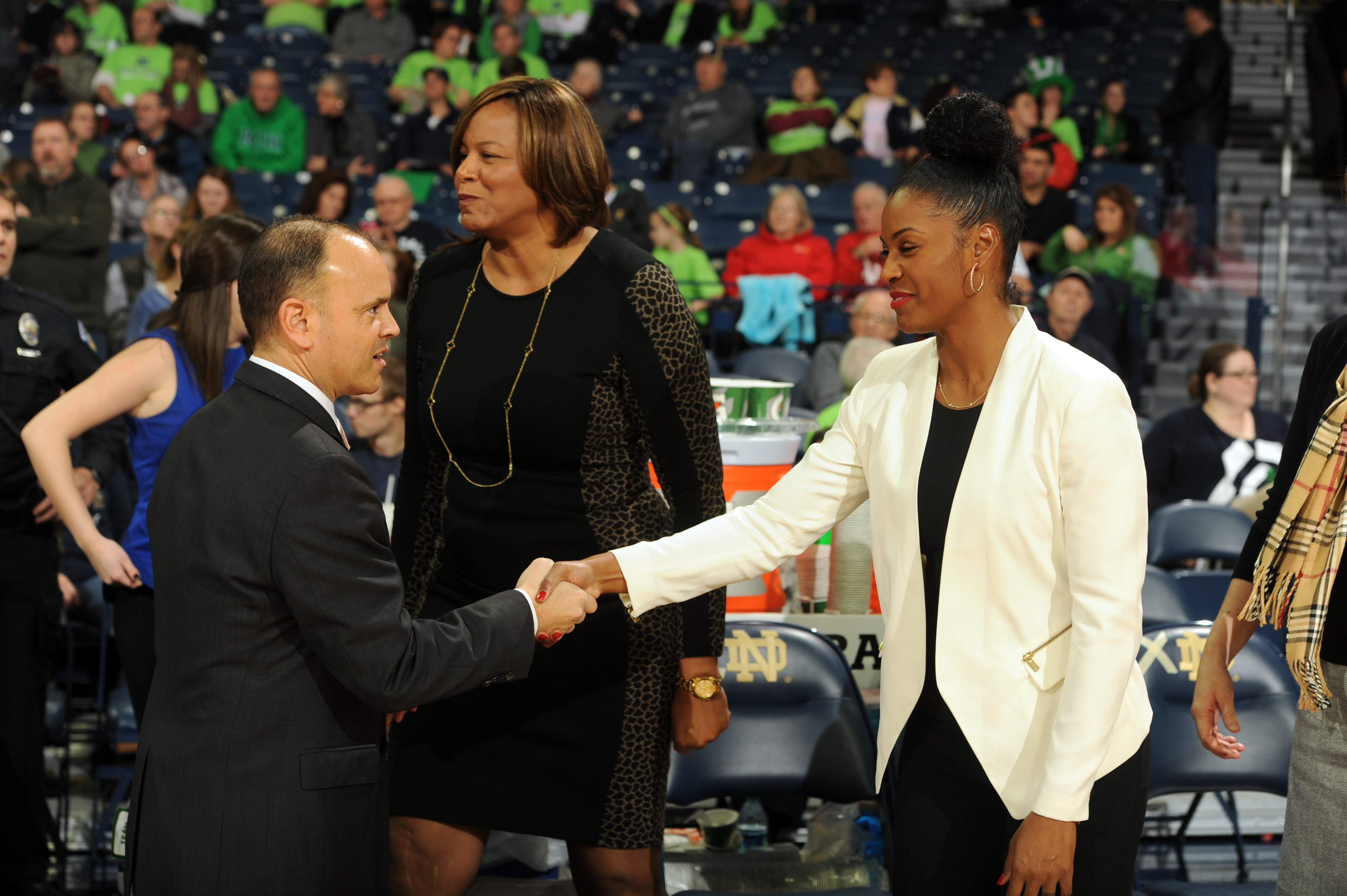 Oregon State coach Scott Rueck shakes hands with Notre Dame assistant Niele Ivey prior to a NCAA college basketball game between Notre Dame and Oregon State, Monday Dec. 28, 2015 in South Bend, Ind. (AP Photo/Joe Raymond)