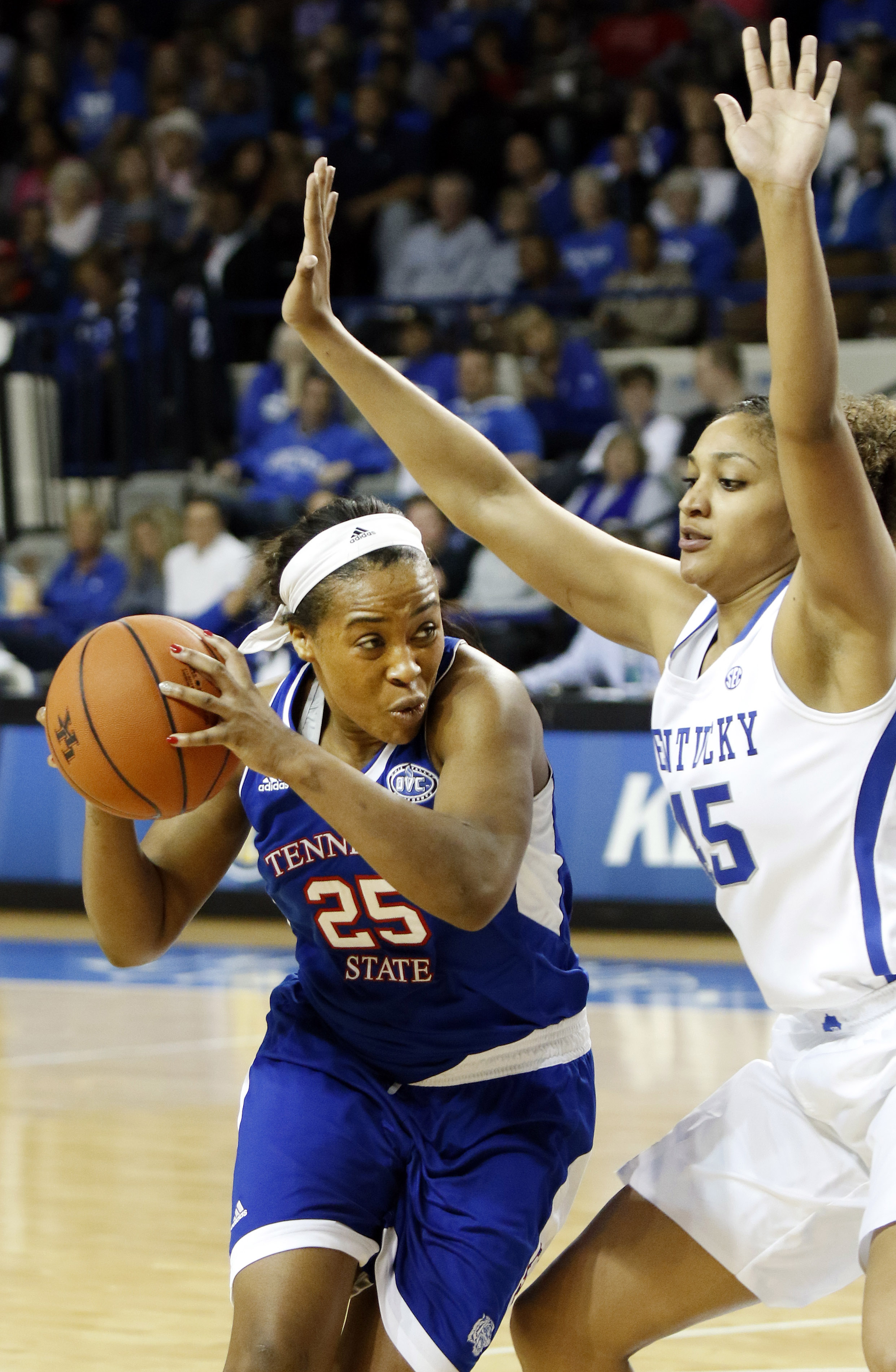 Tennessee State's Jayda Johnson, left, looks for an opening on Kentucky's Alyssa Rice, right, during an NCAA college basketball game Monday, Dec. 28, 2015, in Lexington, Ky. (AP Photo/James Crisp)
