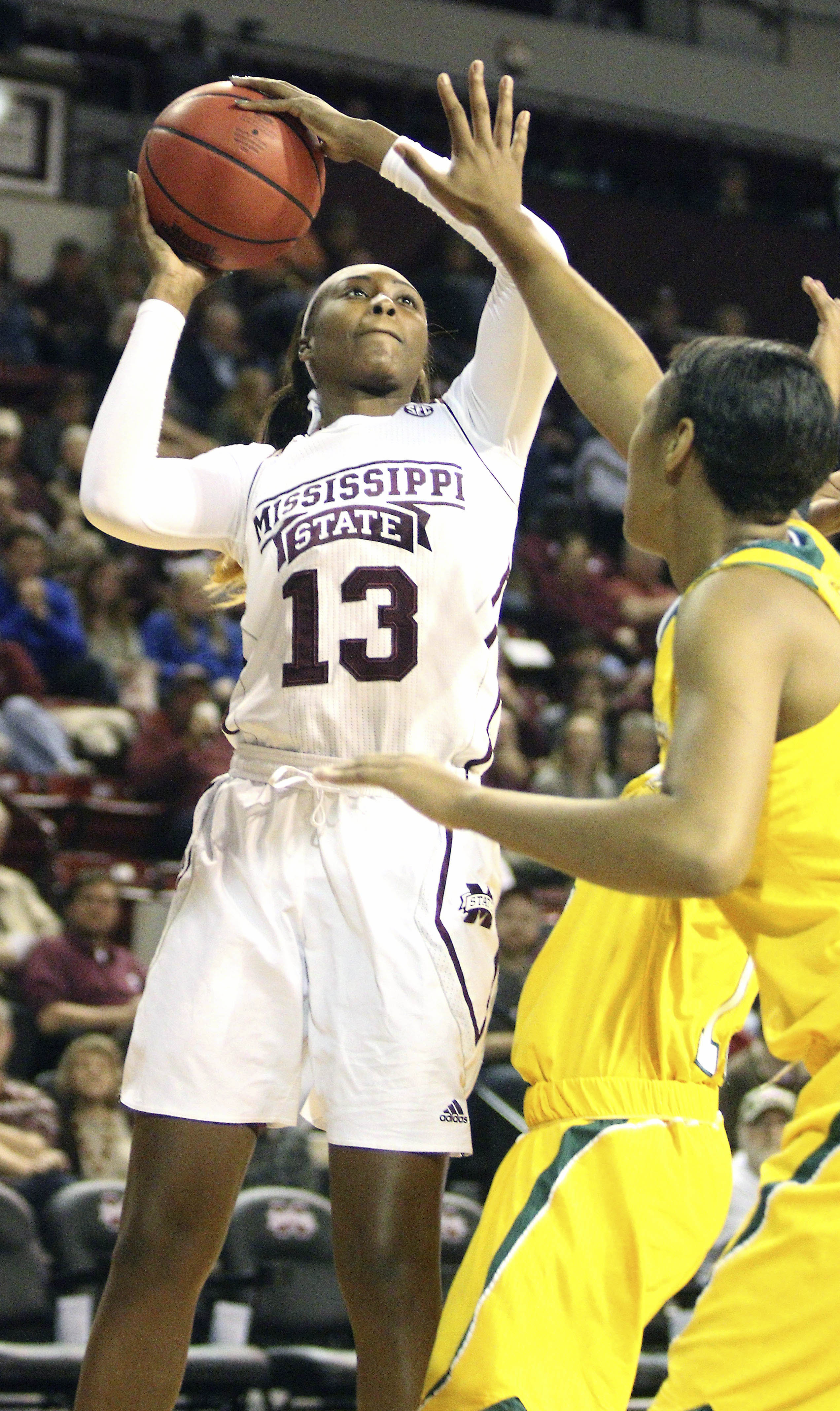 Mississippi State forward Ketara Chapel (13) shoots over Southeastern Louisiana forward Nanna Pool (42) during the first half of an NCAA college basketball game in Starkville, Miss., Monday, Dec. 28, 2015. (AP Photo/Jim Lytle)
