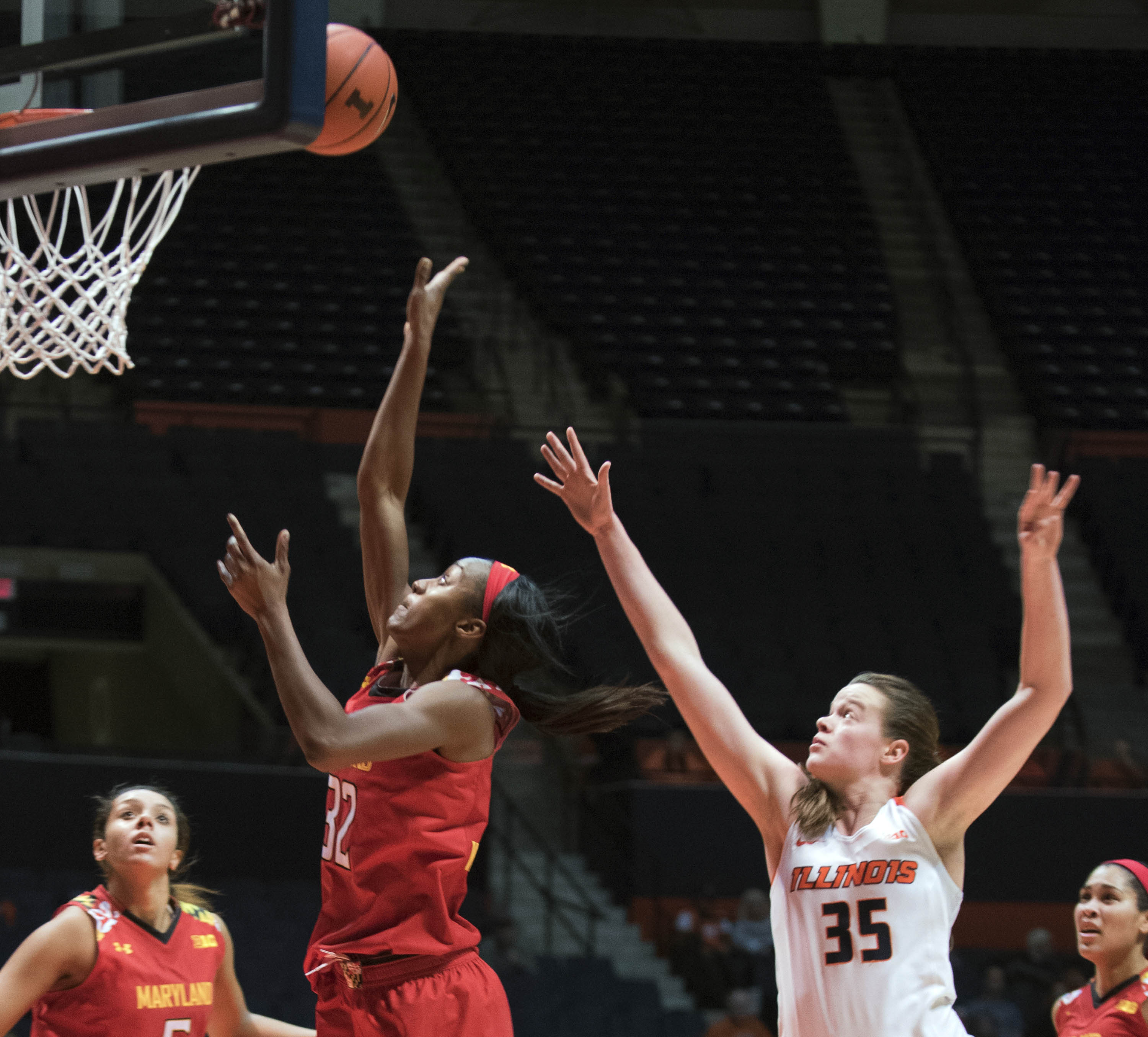 Maryland's guard Shatori Walker-Kimbrough (32) shoots as Illinois' forward Alex Wittinger (35) watches during the second half of an NCAA college basketball game in Champaign, Ill. on Thursday, Dec. 31, 2015. Maryland defeated Illinois 79-63. (AP Photo/Rob