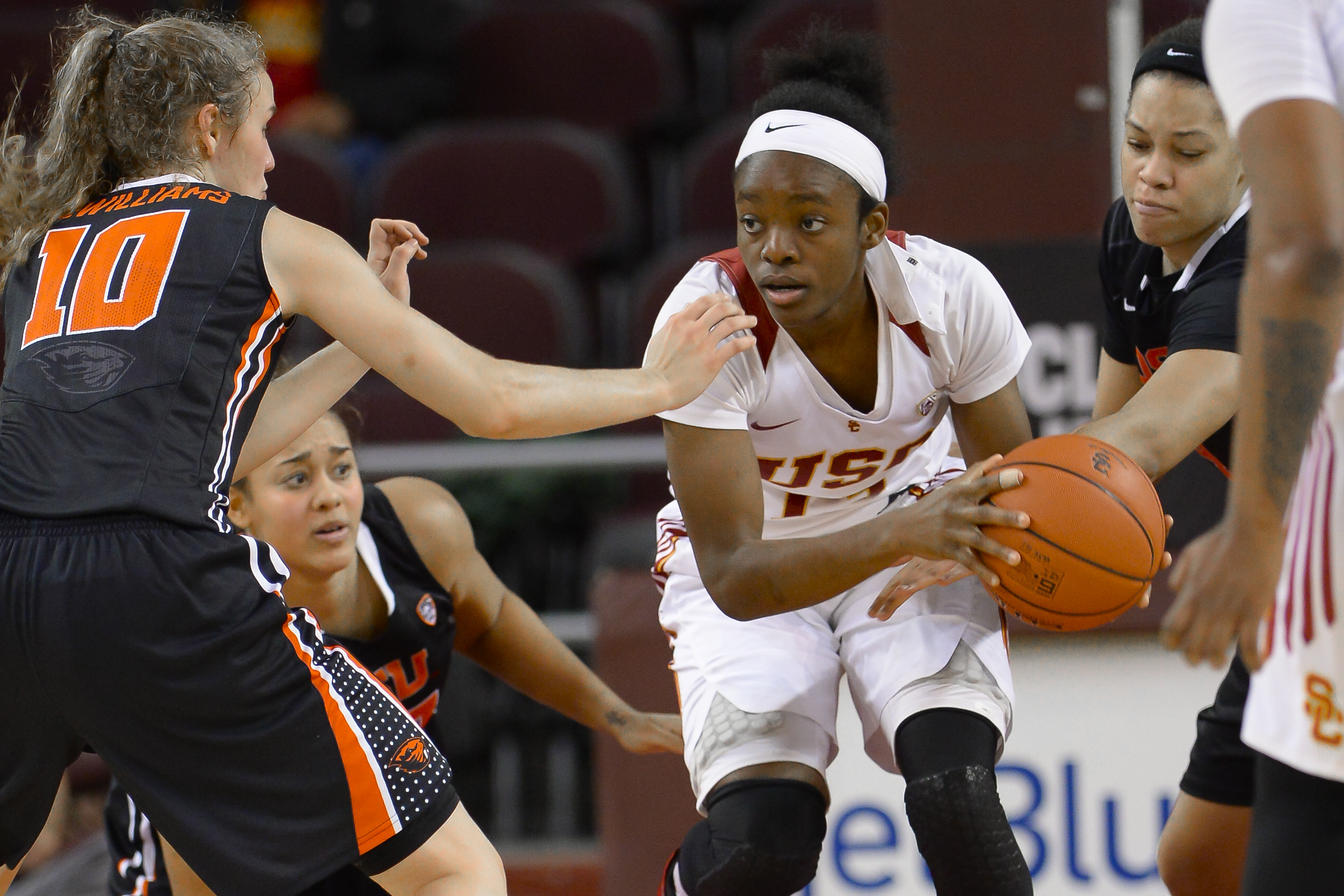 Southern California forward Marguerite Effa, center right, attempts to get by Oregon State guard Katie McWilliams (10) during the first half of an NCAA college basketball game Saturday, Jan. 2, 2016, in Los Angeles. (AP Photo/Gus Ruelas)