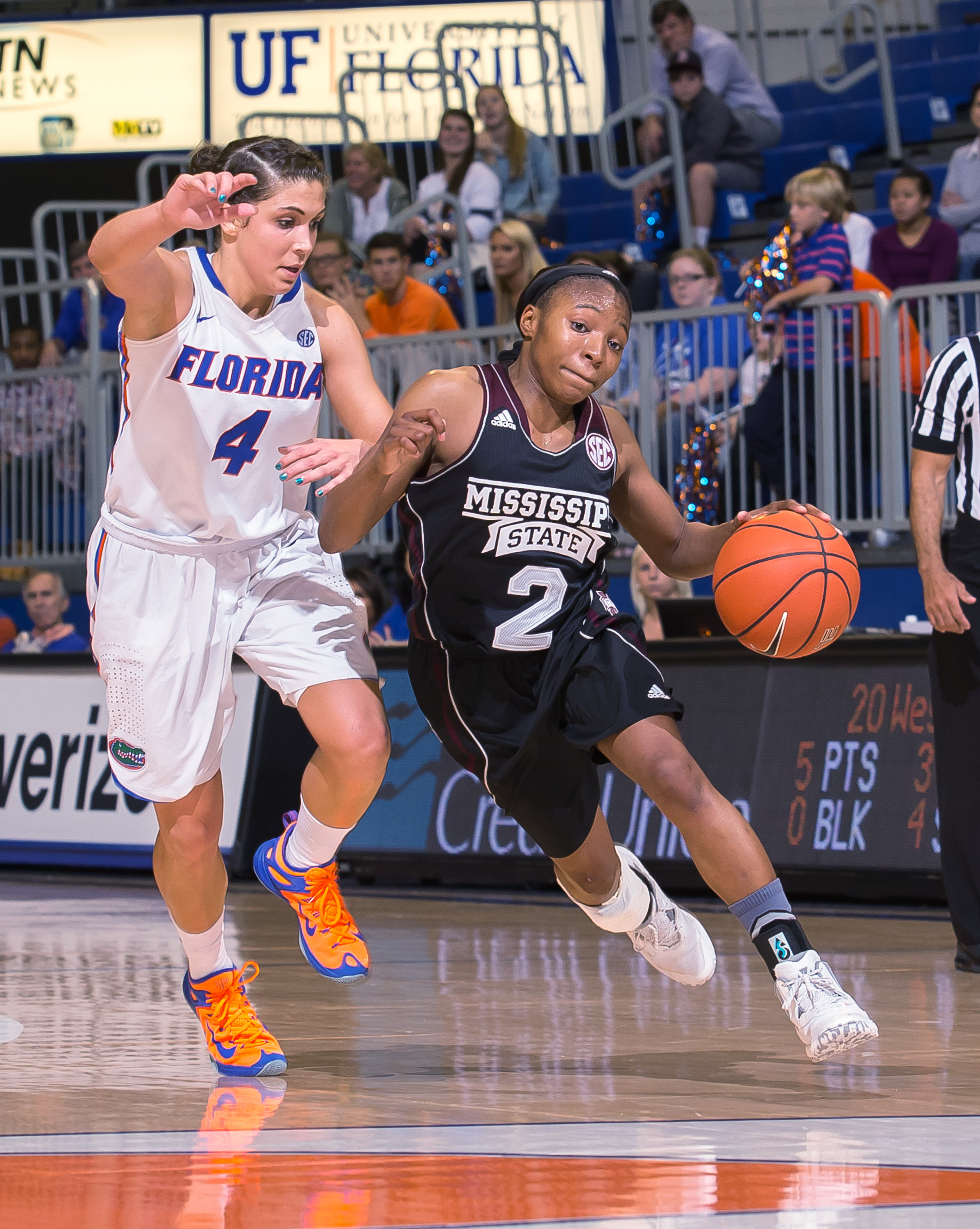 Mississippi State guard Morgan William (2) dribbles past Florida guard Carlie Needles (4) during the second half of an NCAA college basketball game in Gainesville, Fla. on Sunday, Jan. 3, 2016. Mississippi State won 76-70. (AP Photo/Ronald Irby)