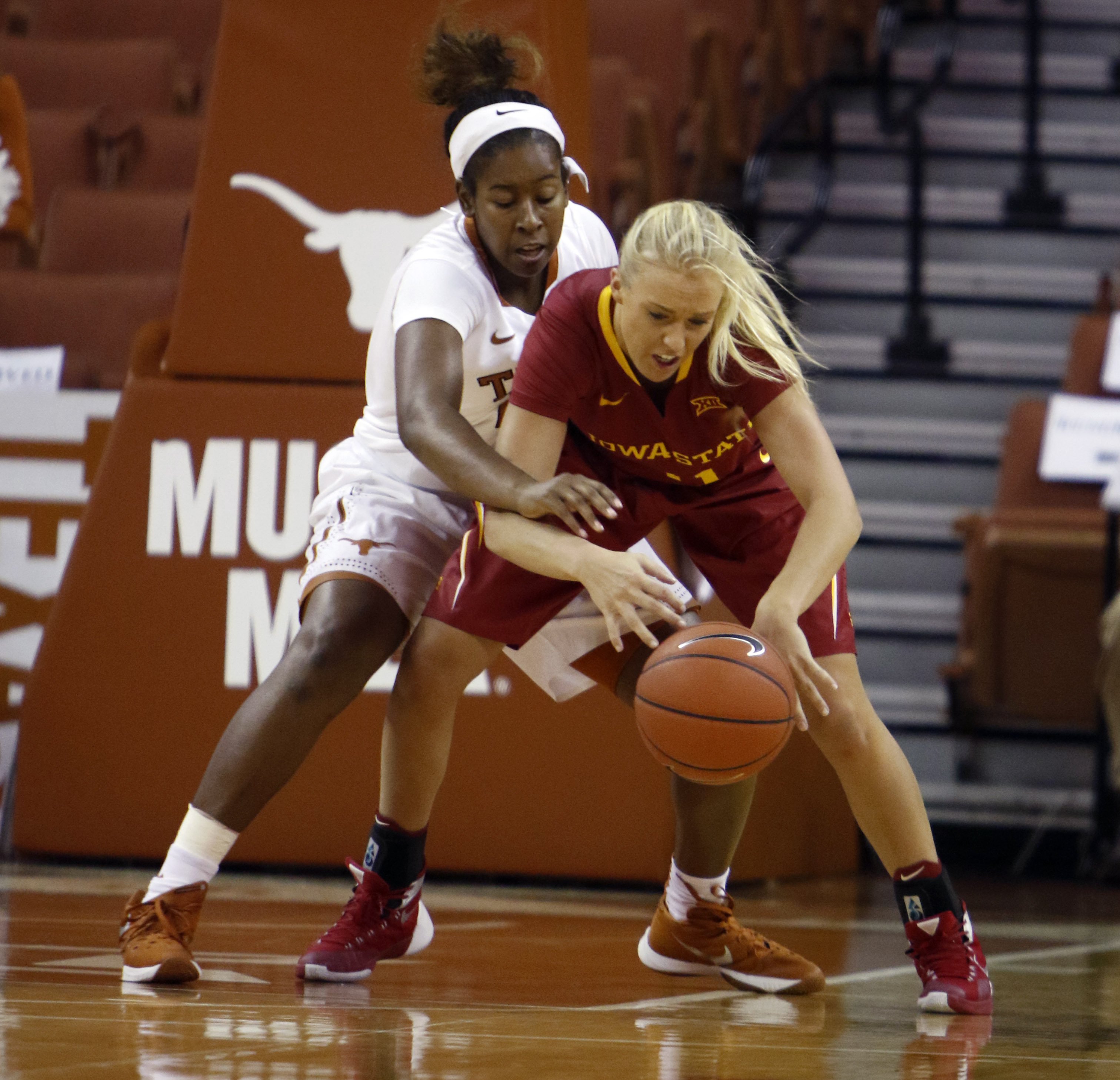 Iowa State guard Jadda Buckley, front, tries to control the ball against Texas guard Lashann Higgs during the first half of an NCAA college basketball game Wednesday, Jan. 6, 2016, in Austin, Texas. (AP Photo/Michael Thomas)