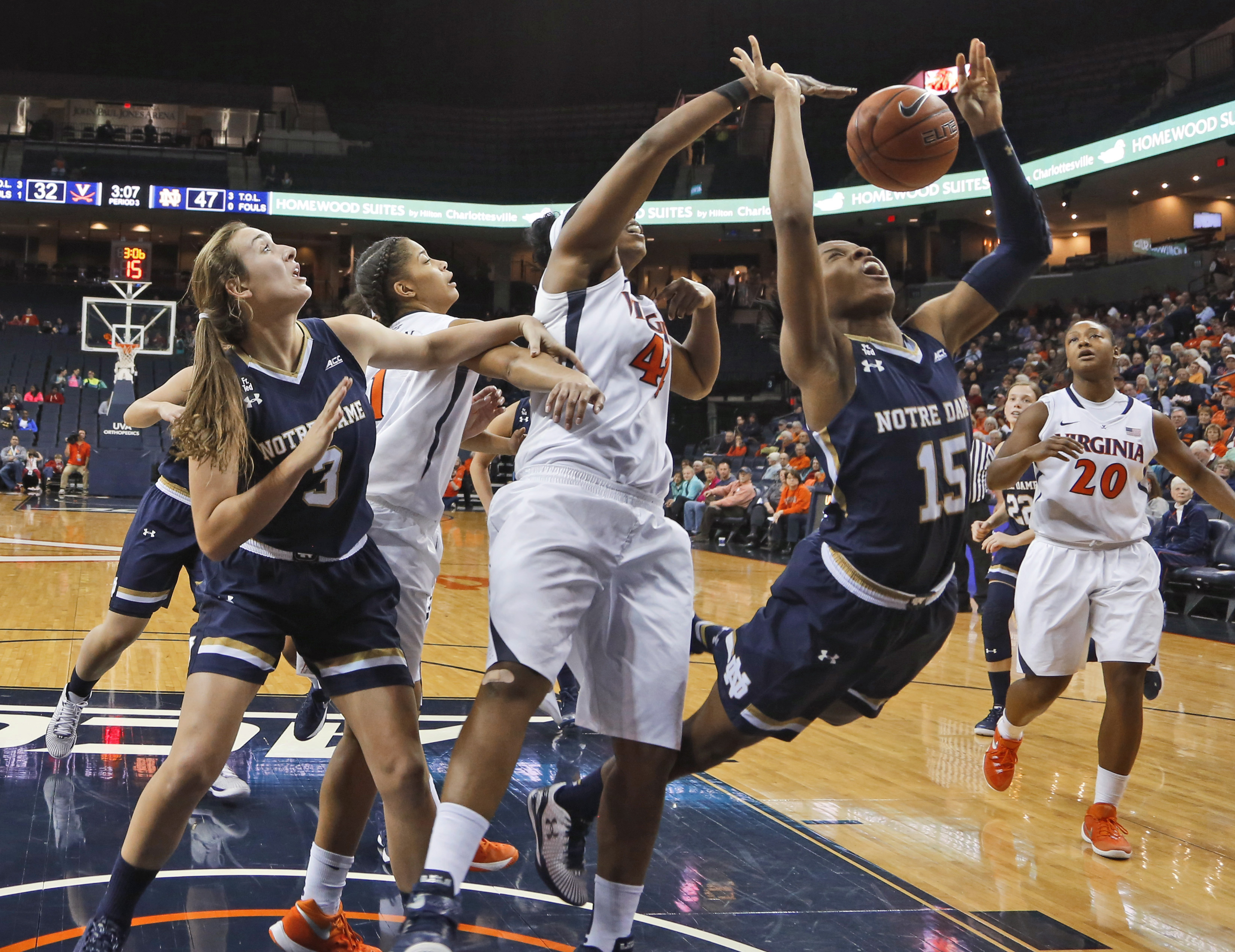 Notre Dame guard Lindsay Allen (15) reaches for a rebound as Virginia forward Sydney Umeri, center, closes in during the second of an NCAA college basketball game in Richmond, Va., Thursday, Jan. 7, 2016. Notre Dame won 74-46. (AP Photo/Steve Helber)