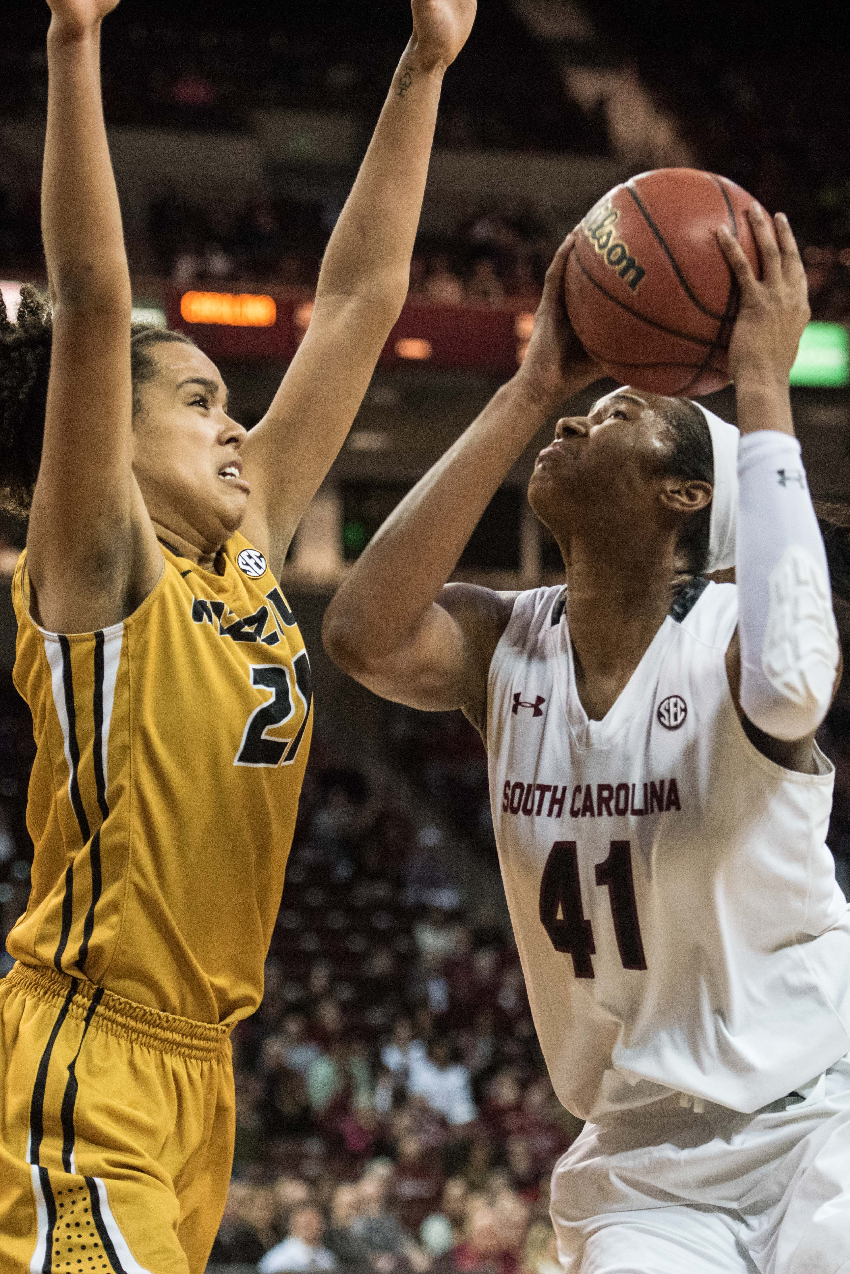 South Carolina center Alaina Coates (41) attempts to shoot against Missouri forward Cierra Porter, left, during the first half of an NCAA college basketball game Sunday, Jan. 10, 2016, in Columbia, S.C. South Carolina defeated Missouri 83-58. (AP Photo/Se