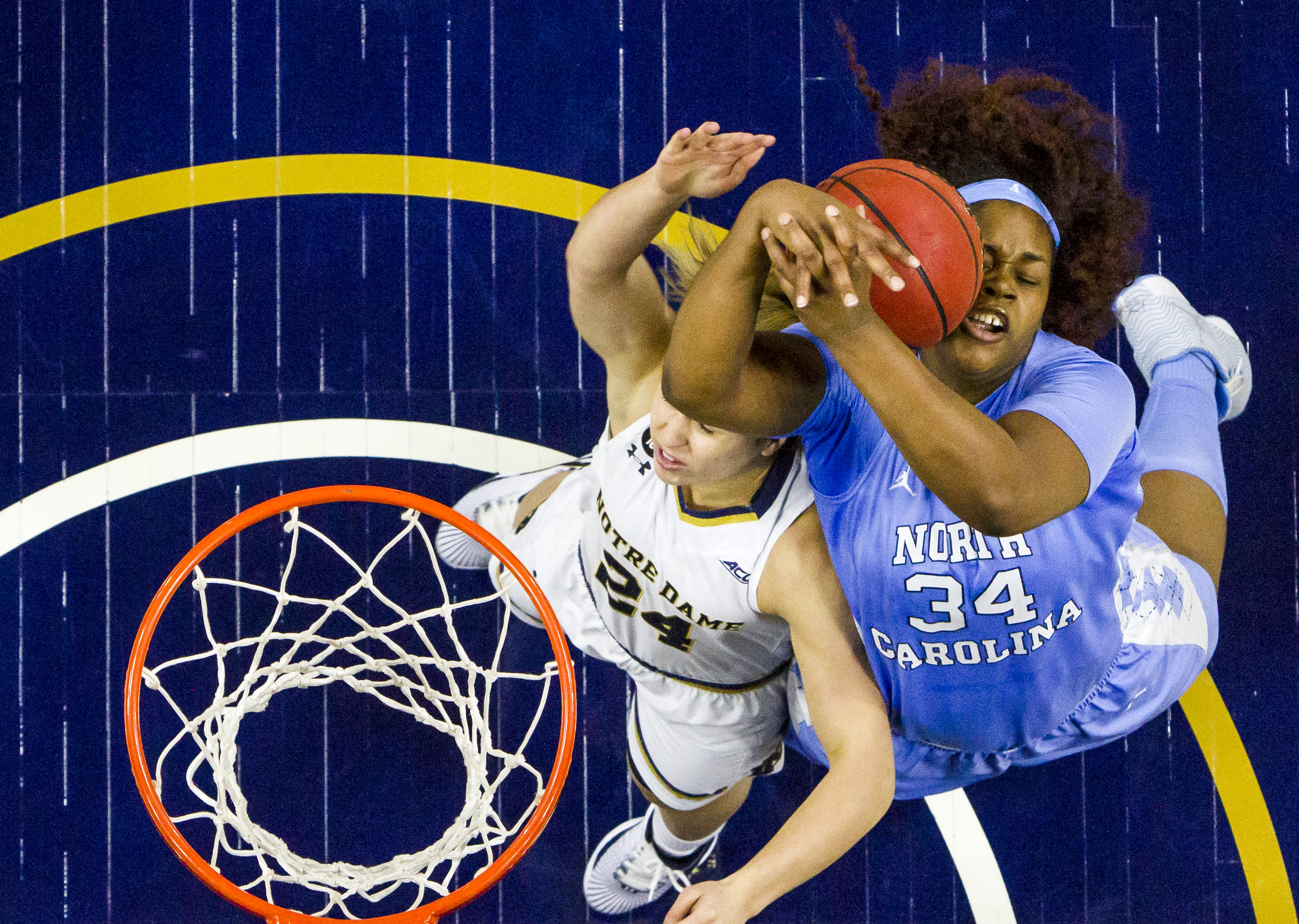 North Carolina's Xylina McDaniel (34) competes for a rebound with Notre Dame's Hannah Huffman (24) during the second half of an NCAA college basketball game on Sunday, Jan. 10, 2016, in South Bend, Ind. (AP Photo/Robert Franklin)