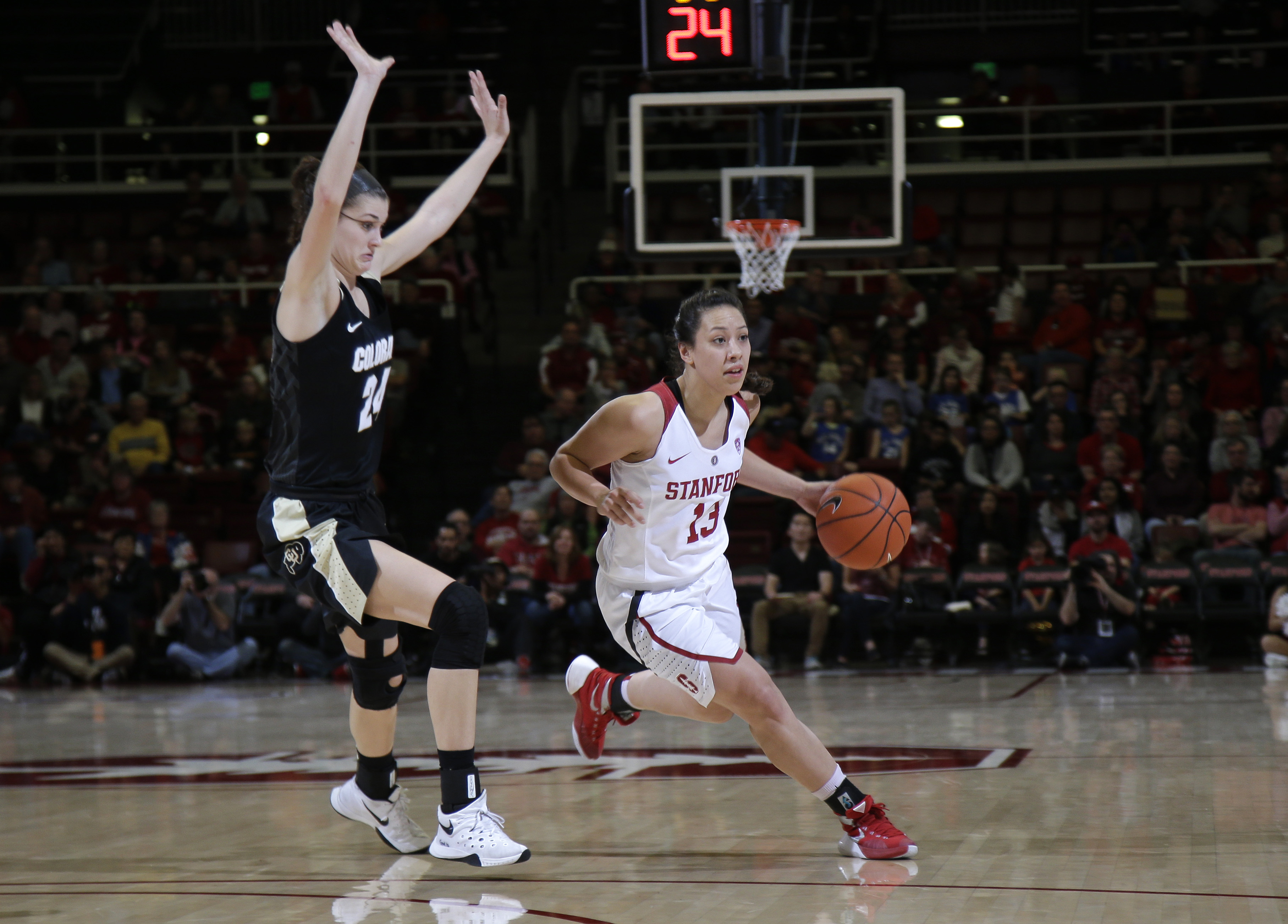 Stanford guard Marta Sniezek (13) dribbles next to Colorado guard Lauren Huggins during the first half of an NCAA college basketball game, Sunday, Jan. 10, 2016, in Stanford, Calif.  (AP Photo/Marcio Jose Sanchez)