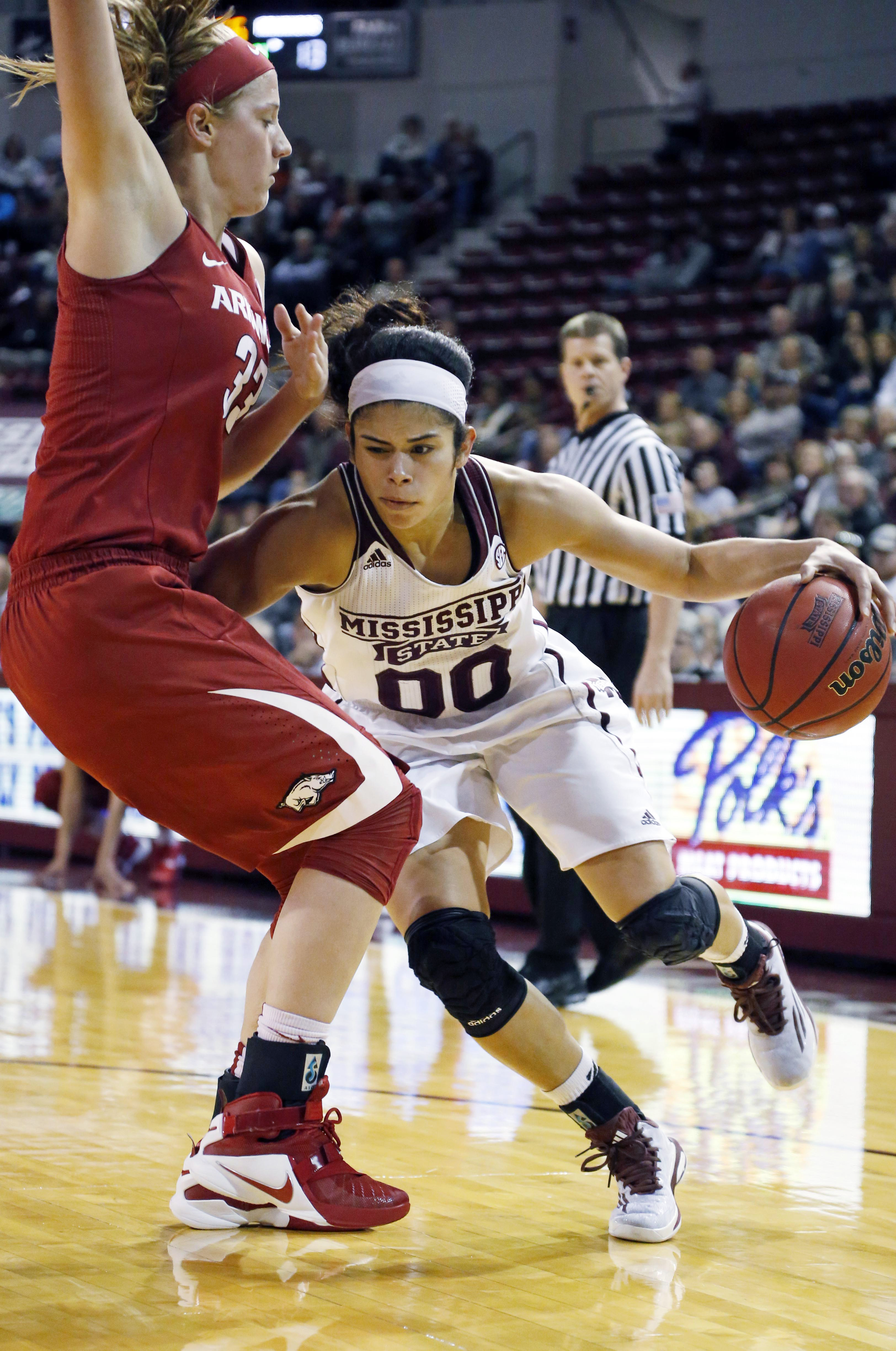 Mississippi State guard Dominique Dillingham (00) pushes her way past Arkansas forward Melissa Wolff (33) as she dribbles towards the basket in the first half of an NCAA college basketball game in Starkville, Miss., Sunday, Jan. 10, 2016. (AP Photo/Rogeli