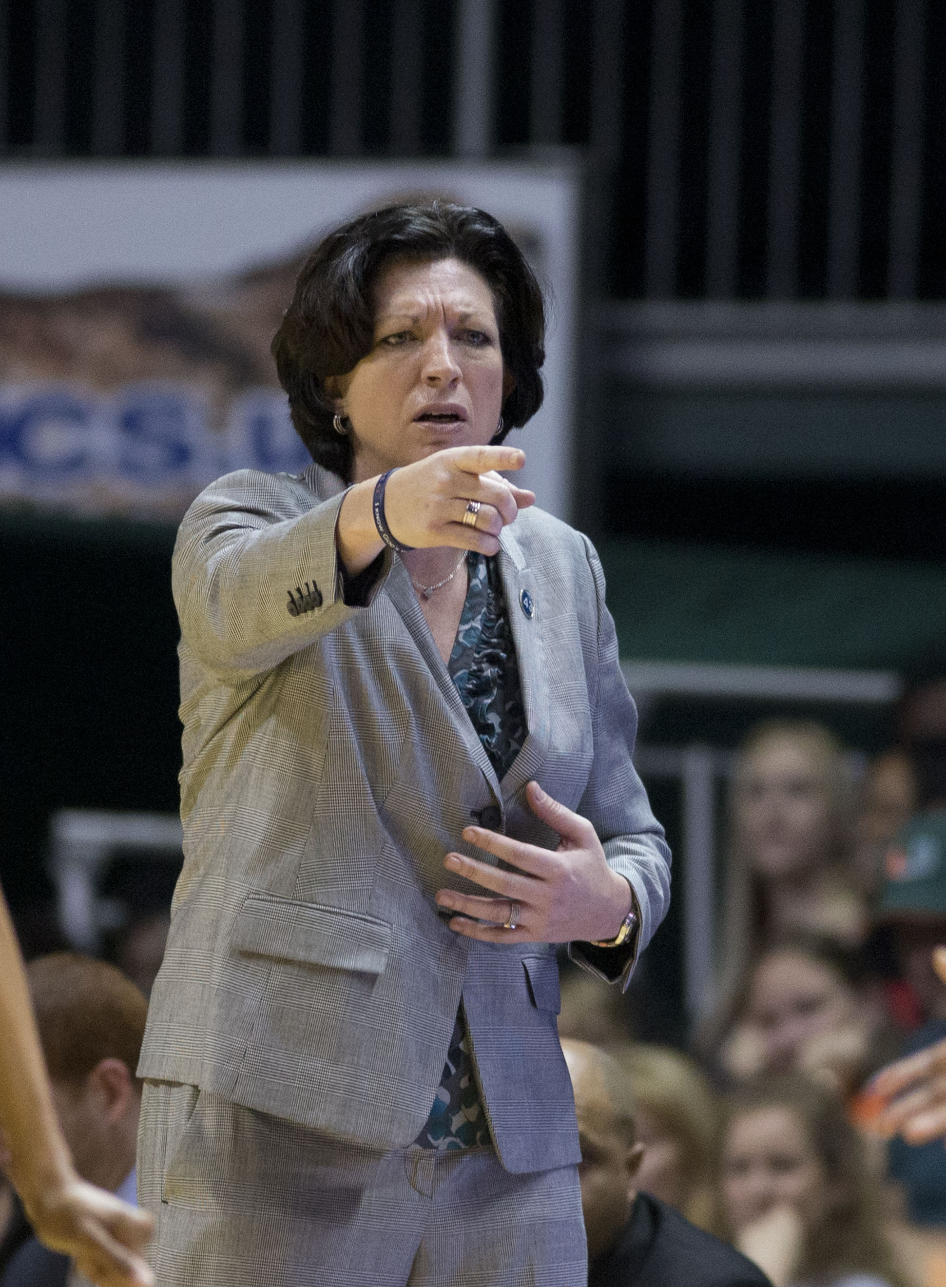 FILE- In this March 1, 2015, file photo, Miami coach Katie Meier yells instructions during the first half of an NCAA college basketball game against Florida State in Coral Gables, Fla. For the first time in the 701 weeks of The Associated Press women's ba