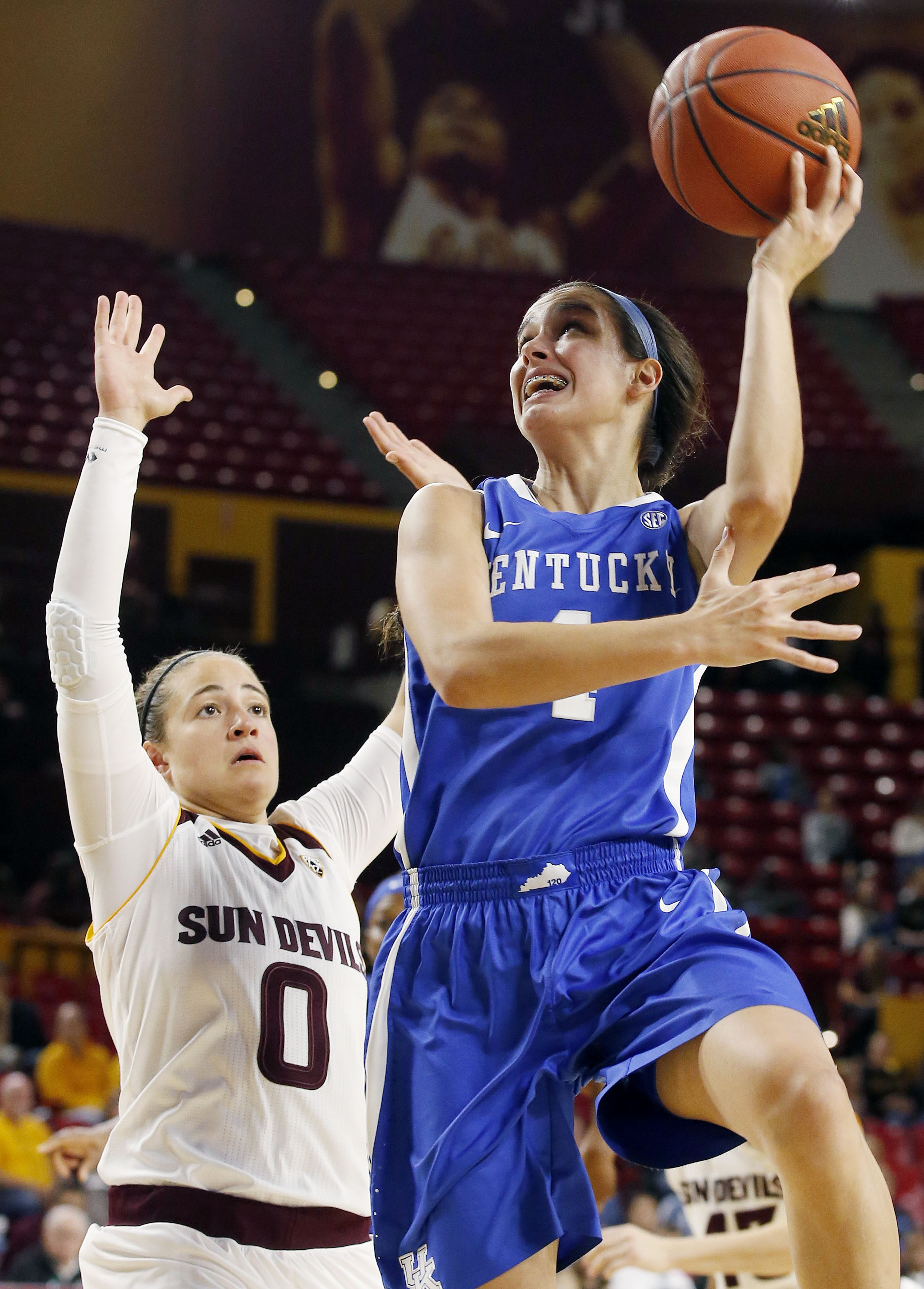 FILE - This Nov. 15, 2015 file photo shows Kentucky's Maci Morris, right, trying to get off a shot as Arizona State's Katie Hempen (0) defends during the first half of an NCAA college basketball game in Tempe, Ariz. Morris thought she would spend most of