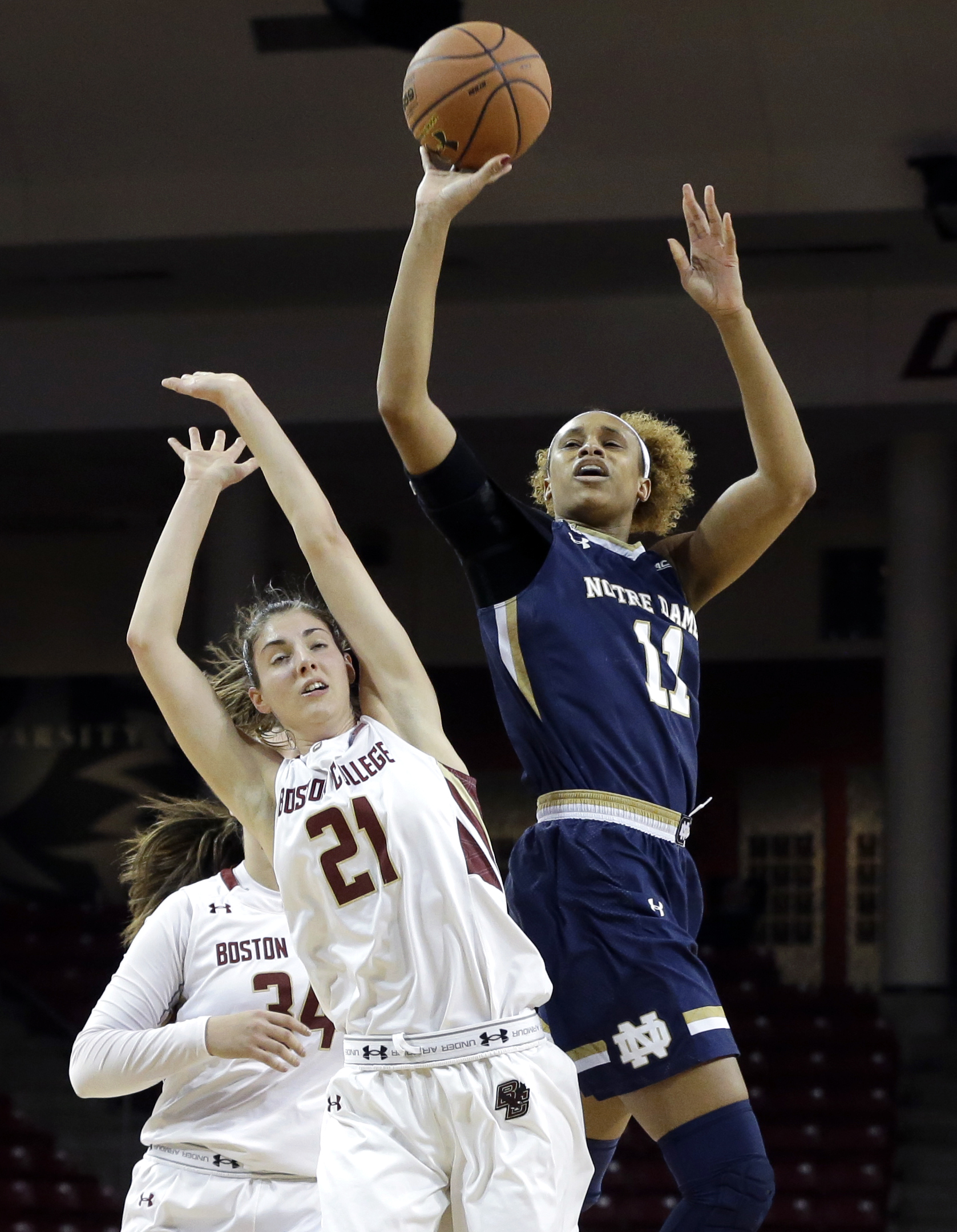 Notre Dame's Brianna Turner (11) gets a shot off against Boston College's Marti Mosetti (21) with a second left  in the first quarter of an NCAA college basketball game in Boston, Thursday, Jan. 14, 2016. (AP Photo/Elise Amendola)